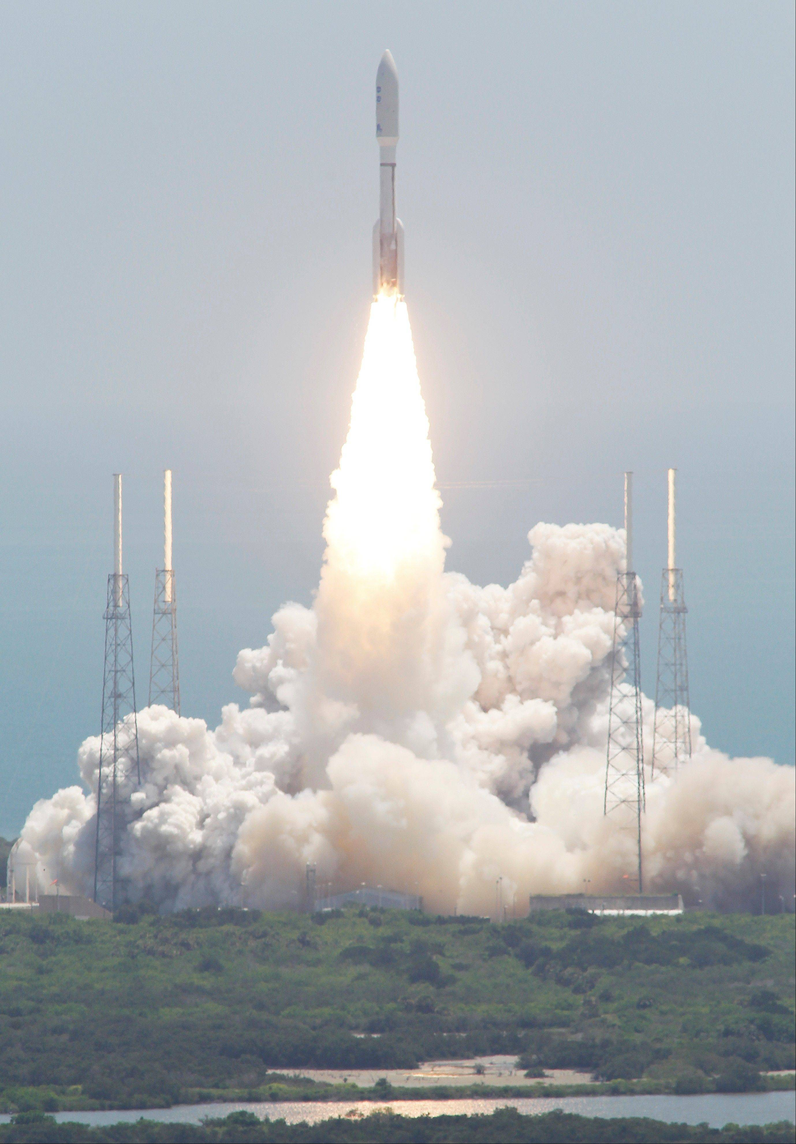 An Atlas V rocket with the Juno spacecraft lifts off Friday from Space Launch Complex-41 in Cape Canaveral, Fla.