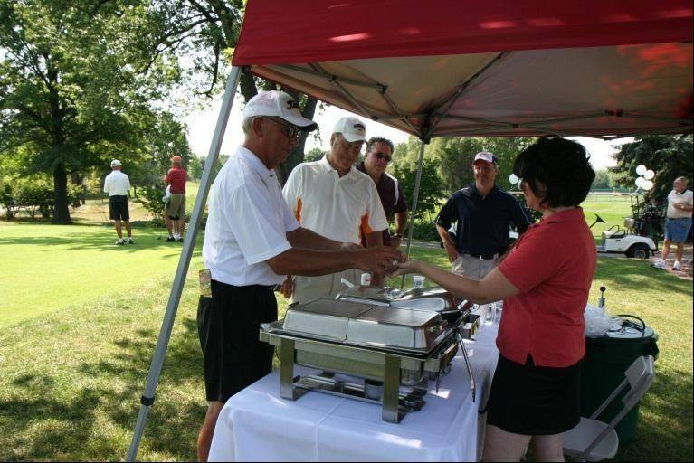 During a previous Links Technology Cup event, Chandler�s Chophouse distributes food to golfers on the course.