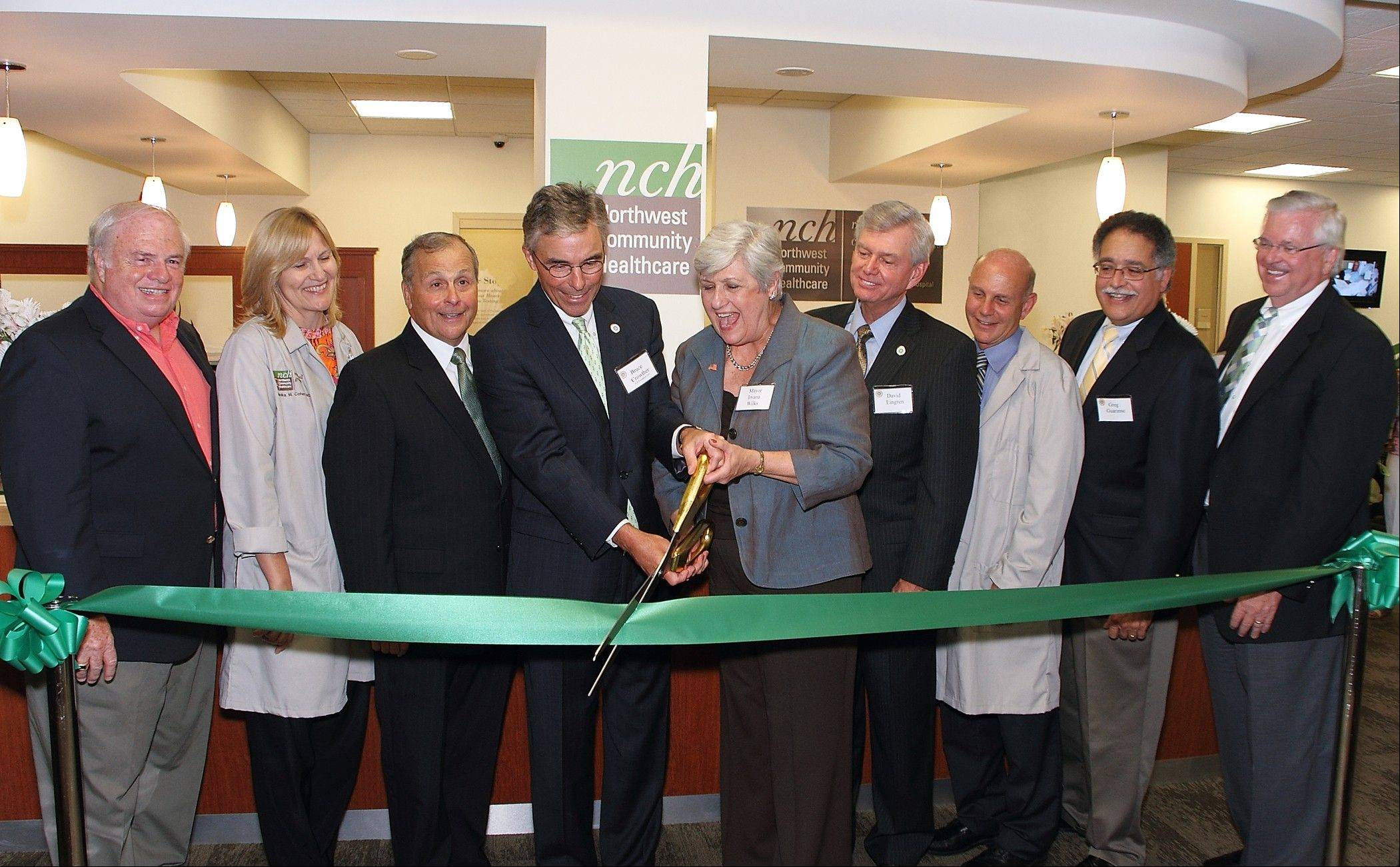 Business and community leaders join Bruce Crowther, president and chief executive officer of Northwest Community Hospital, and Mount Prospect Village President Irvana Wilks at the hospital�s new health center. The Mount Prospect center will hold an open house Saturday, Aug. 6.