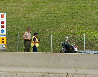 The Lisle Fire Department and state police respond to a motorcycle accident Friday on I-88 hear the Morton Arboretum.