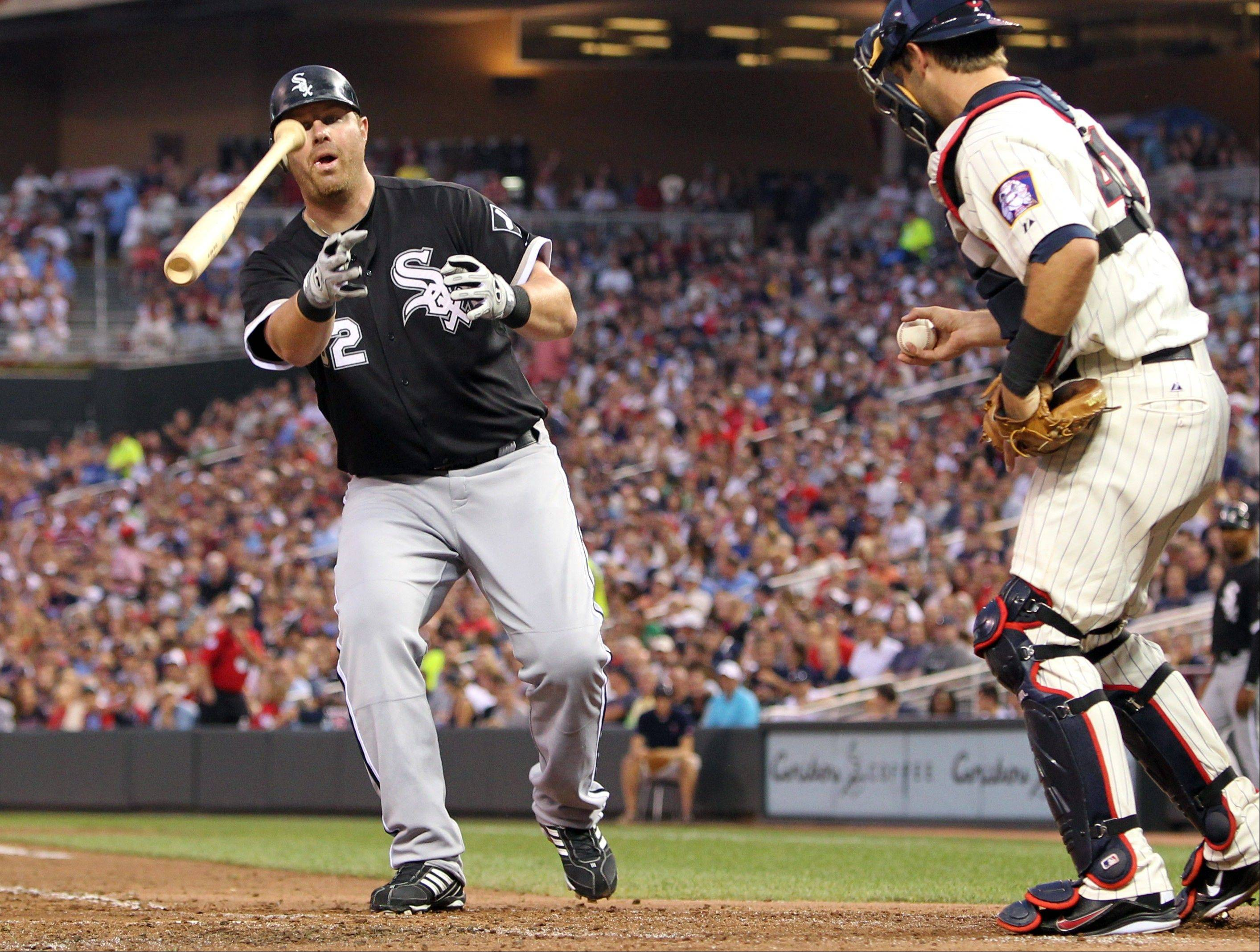 Adam Dunn tosses his bat after drawing 1 of 7 walks by White Sox hitters Friday. Dunn scored on Carlos Quentin's 2-run homer in the fifth inning.
