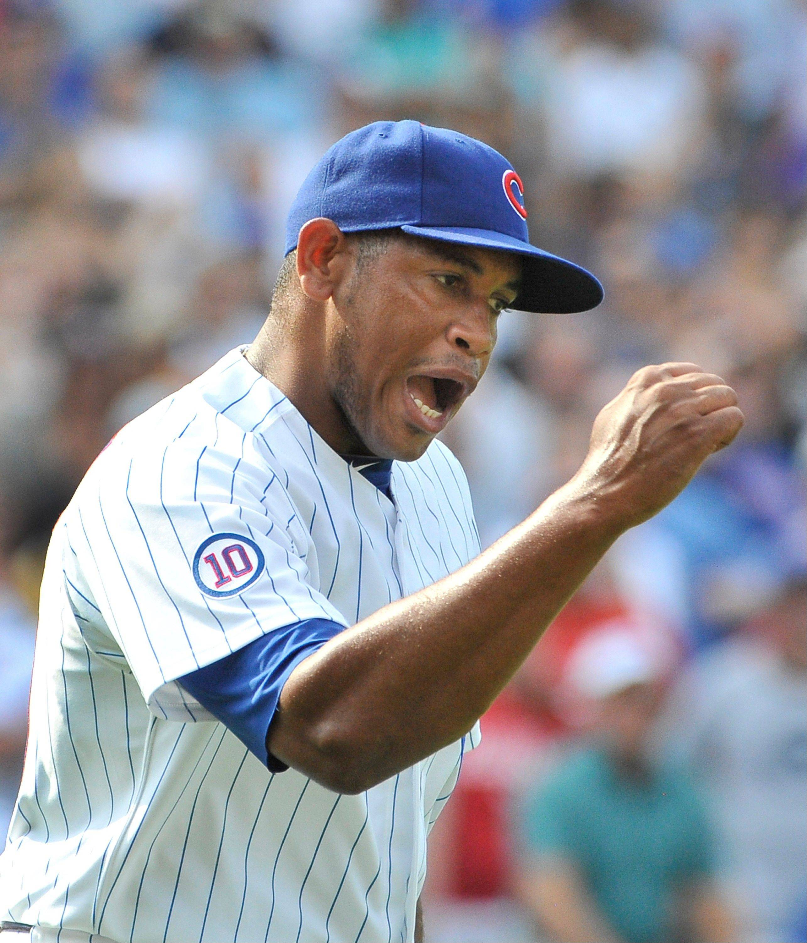 Carlos Marmol notched his 24th save Friday by holding off the Reds in a 4-3 Cubs victory.
