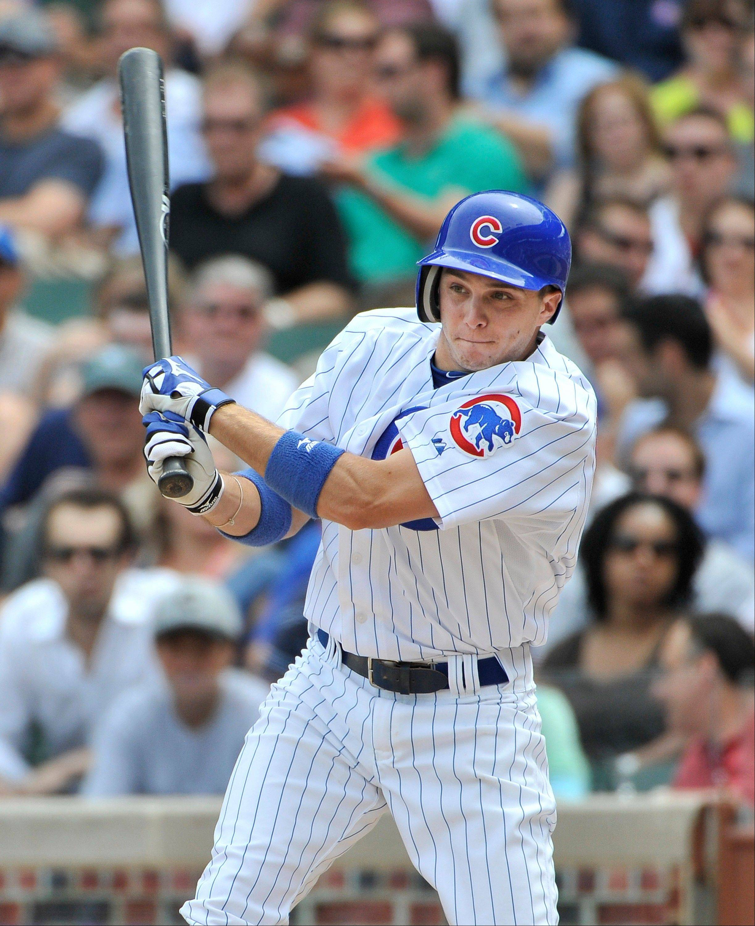 Tony Campana follows through on what turned into a 2-run inside-the-park home run during the first inning of the Cubs� 4-3 victory over Cincinnati at Wrigley Field on Friday.