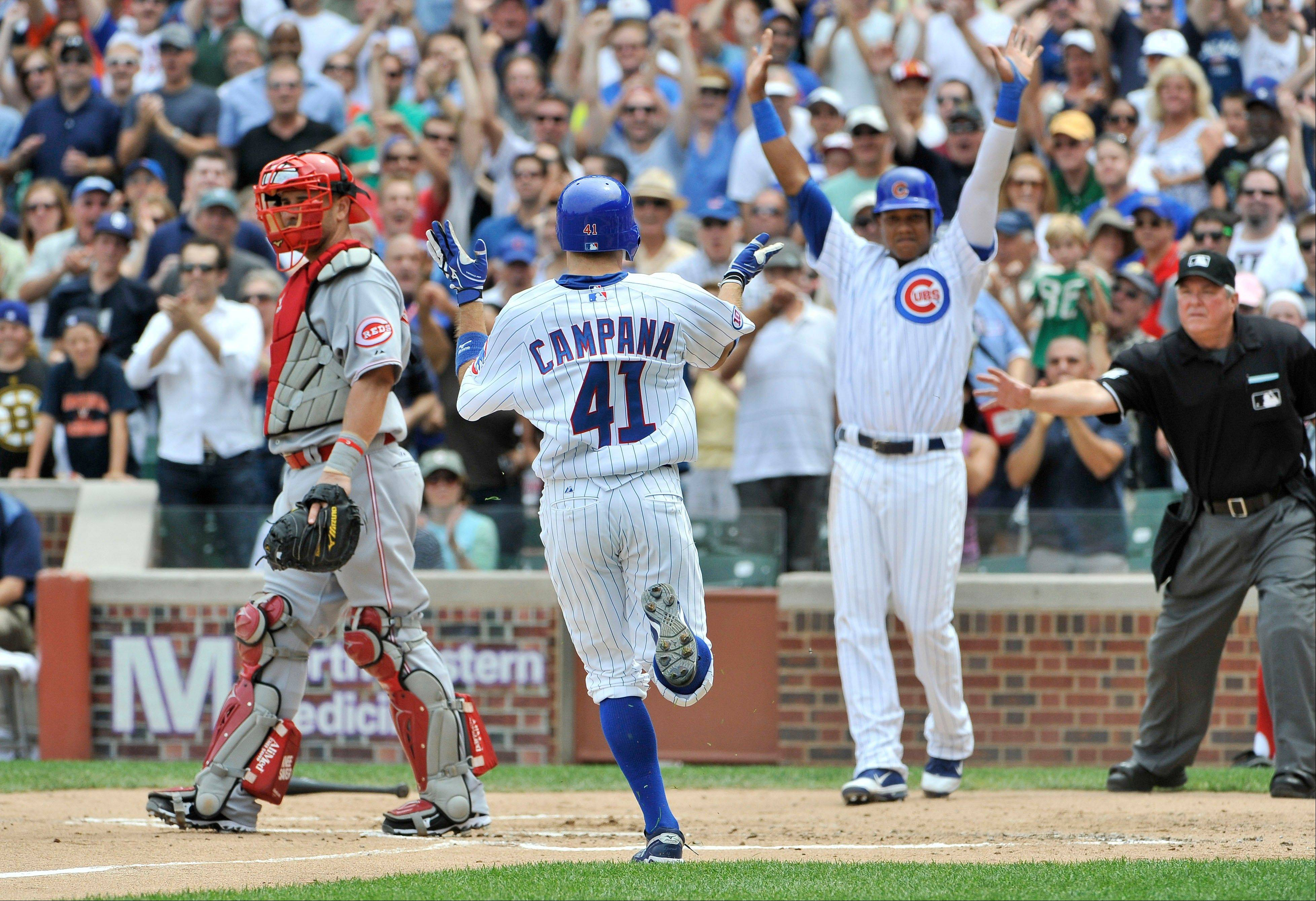 The Cubs� Tony Campana, center, heads toward home plate after hitting a 2-run inside-the-park home run that scored Starlin Castro, right. It was the first inside-the-park homer at Wrigley Field since 2001.