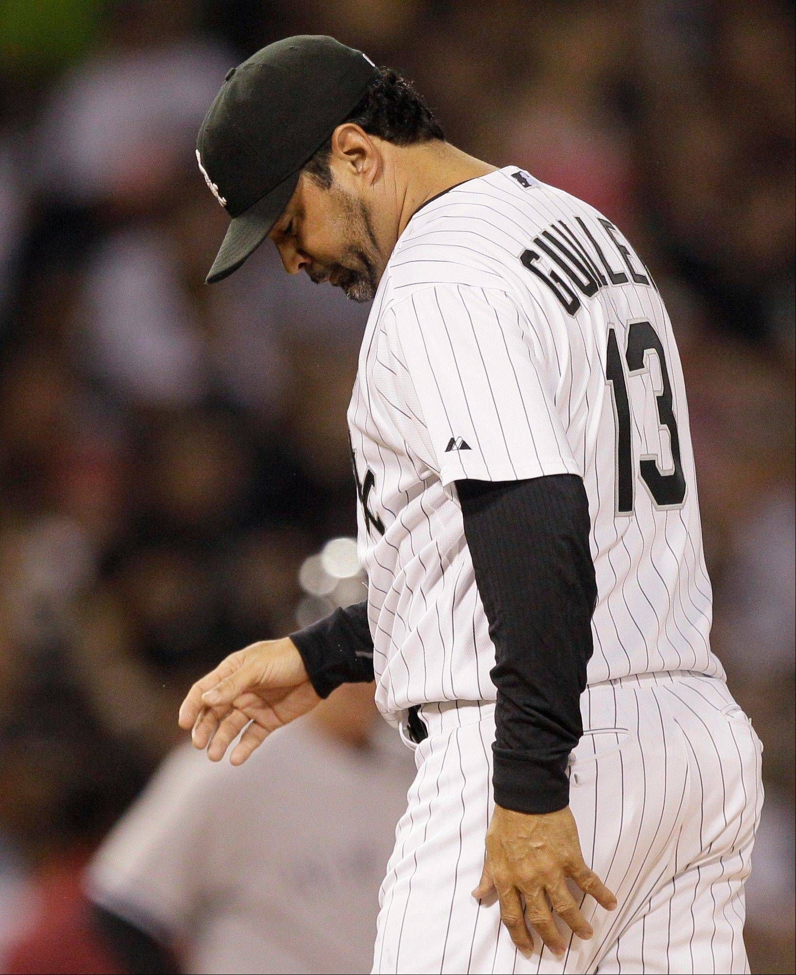 White Sox manager Ozzie Guillen walks back to the dugout after removing starting pitcher Philip Humber on Thursday night.