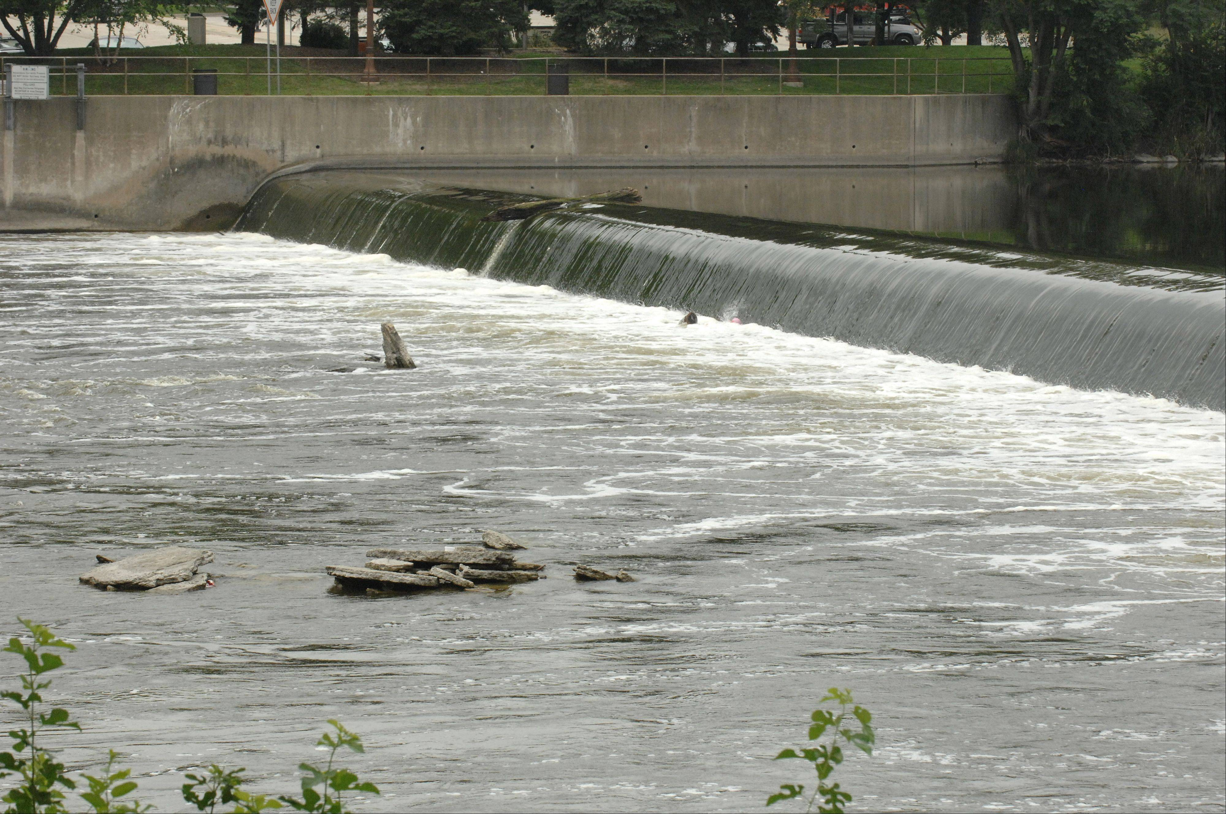 A man and older boy were rescued from a boil in the Geneva dam by a passing group of bicyclists from Naperville on Friday. The man, from Bolingbrook, later died, police said Friday night.