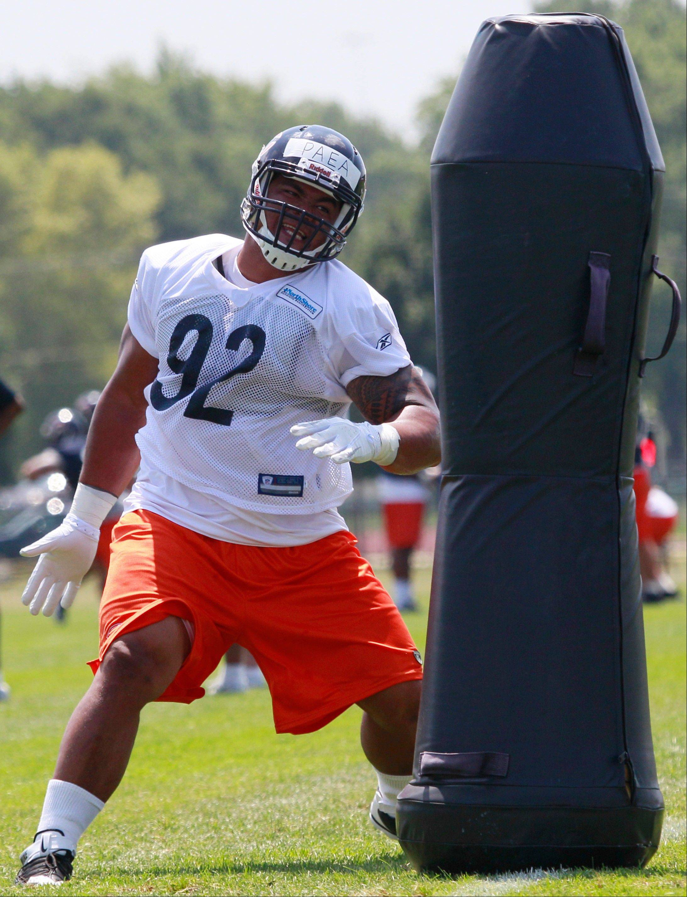Chicago Bears' Stephen Paea works out during NFL football training camp Sunday at Olivet Nazarene University in Bourbonnais.