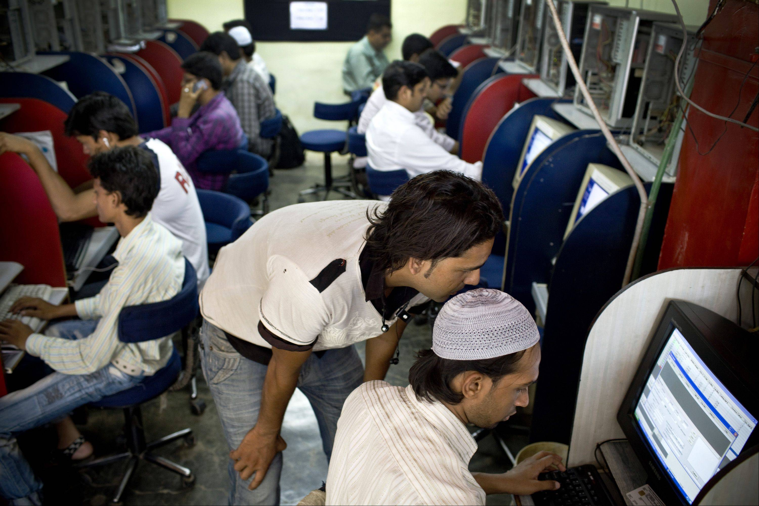 Vijay Singh, 25, bottom right, registers at an Internet cafe in Mumbai, India, on Wednesday. New regulations in India prohibit websites and service providers from hosting information that could be regarded as �harmful,� �blasphemous� or �insulting� to any other nation, among other things.