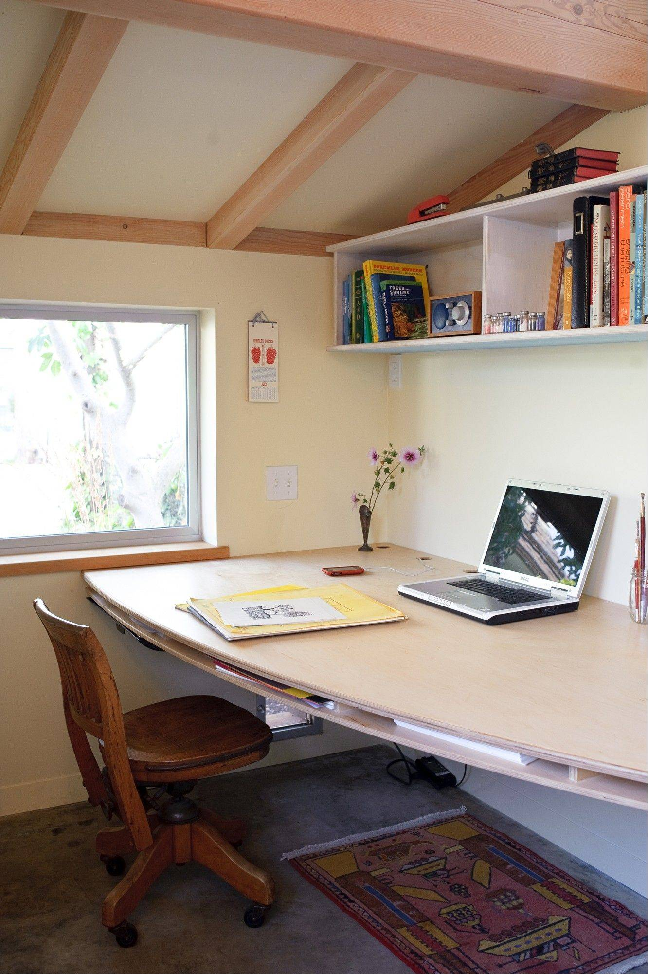Architect Sarah Deeds used a sail-shaped desk to work with the mere 120 square feet in her stand-alone office in Berkeley, Calif.