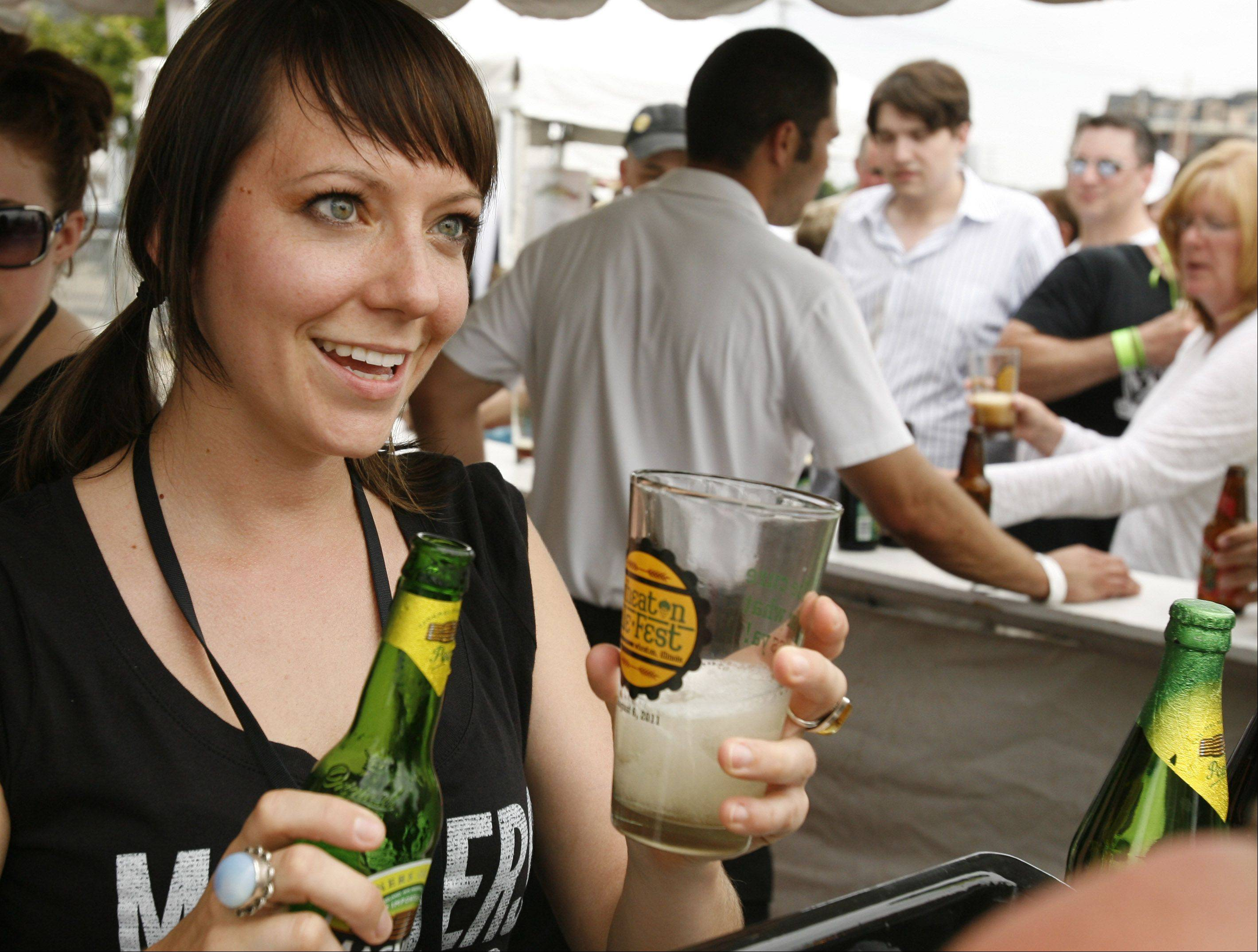 Dalia Satas serves up a Magners Irish Cider Saturday during the first Wheaton Ale Fest, an event featuring more than 100 craft beers in downtown Wheaton.