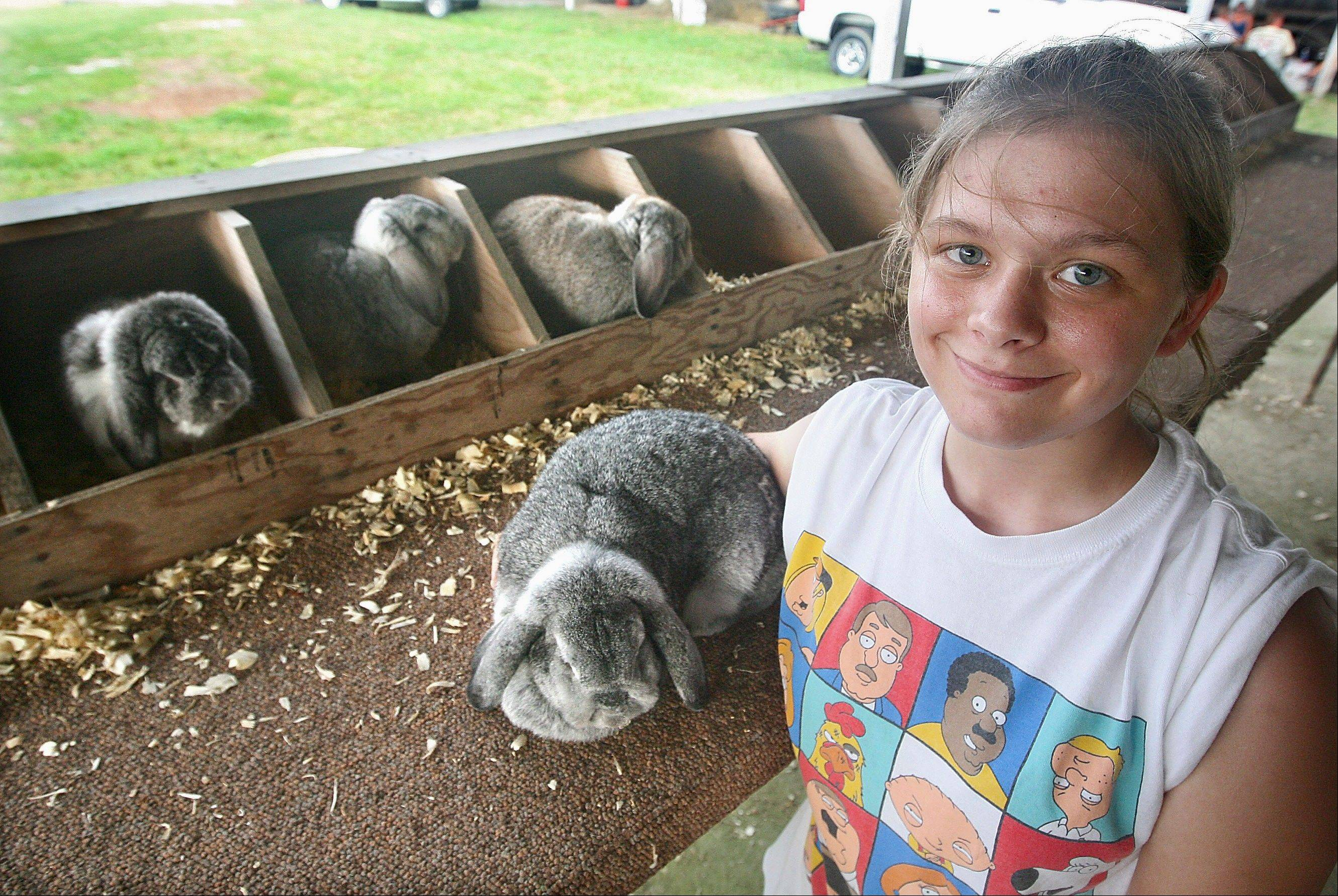 Kayla Obert, 20, of Quincy brought 53 rabbits to the Adams County fair.