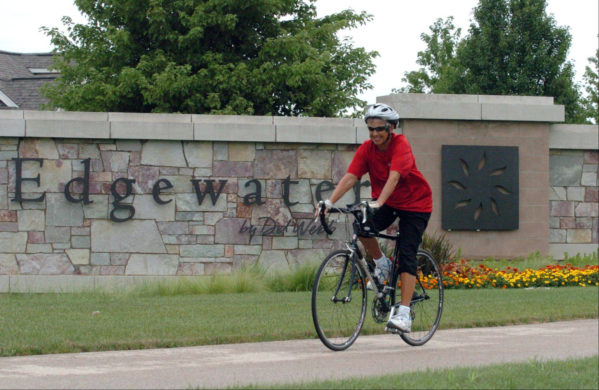 Marina Wray of Elgin takes her usual bike ride on the scenic paths of Del Webb's Edgewater active adult community.