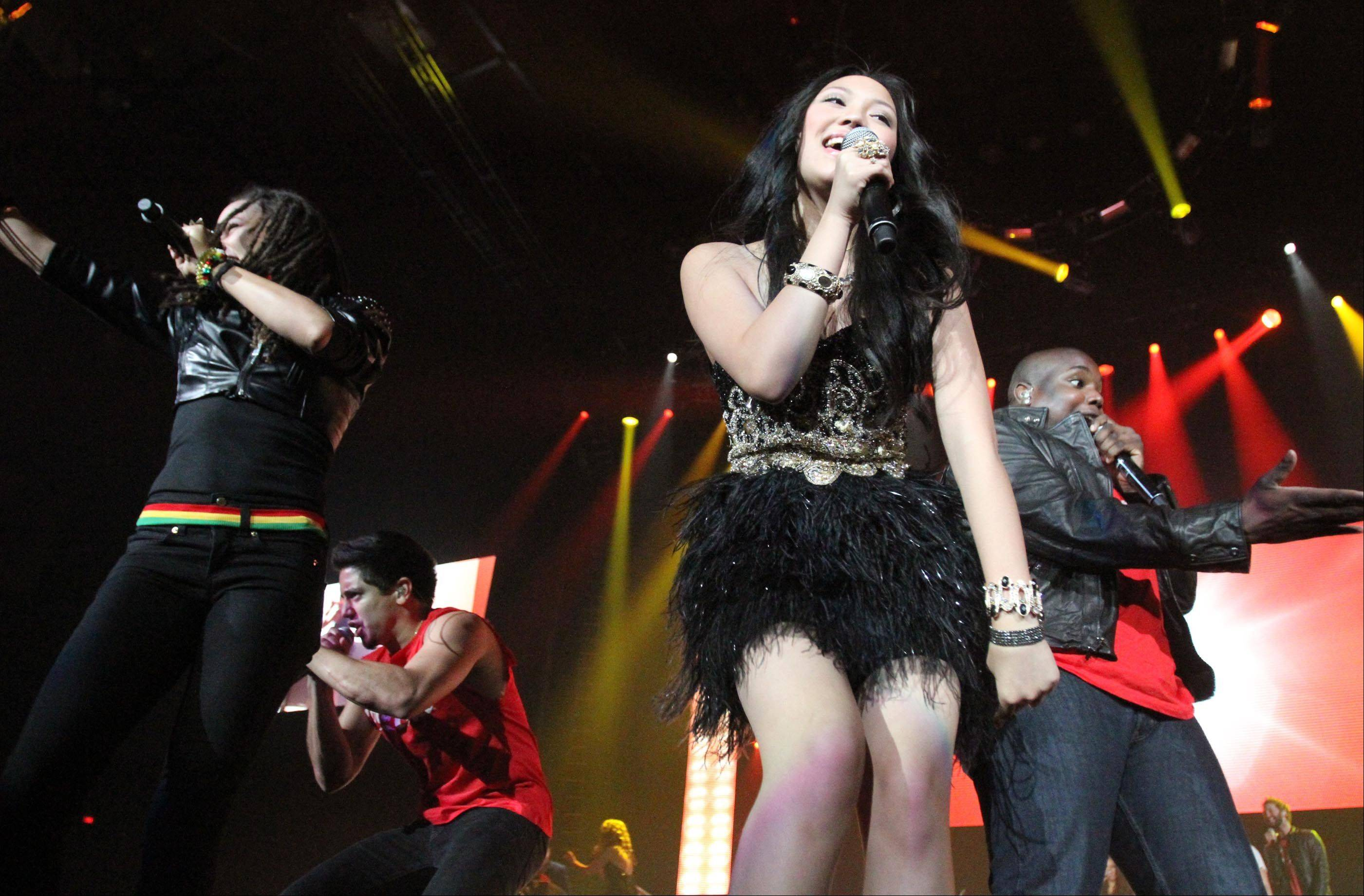 All the American Idol finalists performed for the last song.