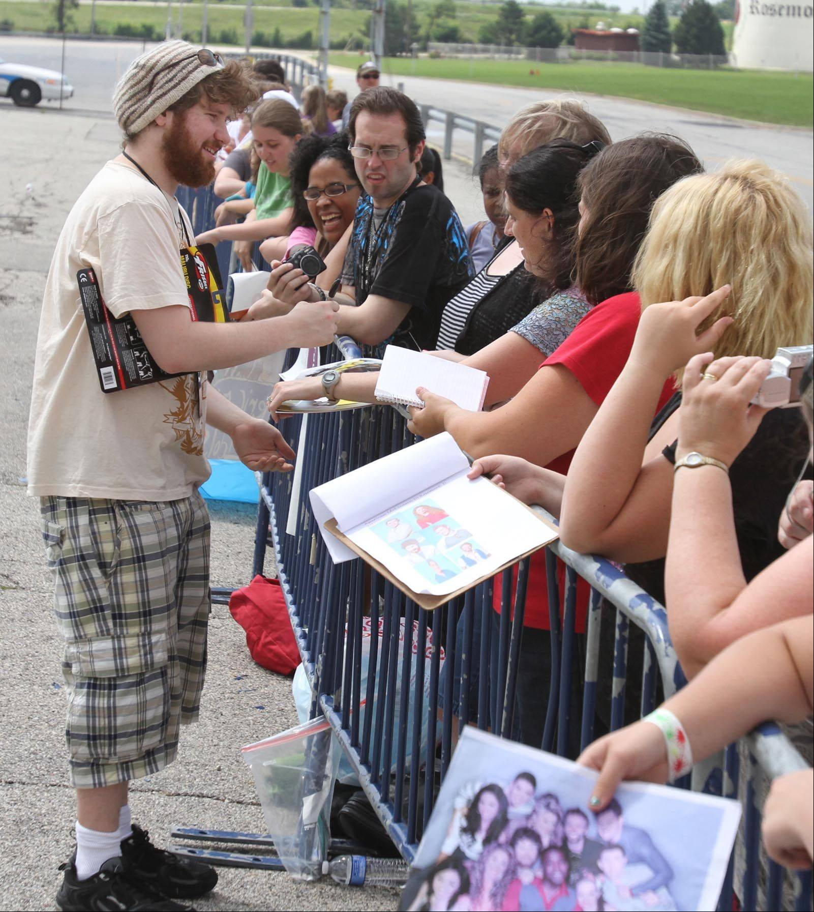 Casey Abrams signs autographs for fans before the concert.