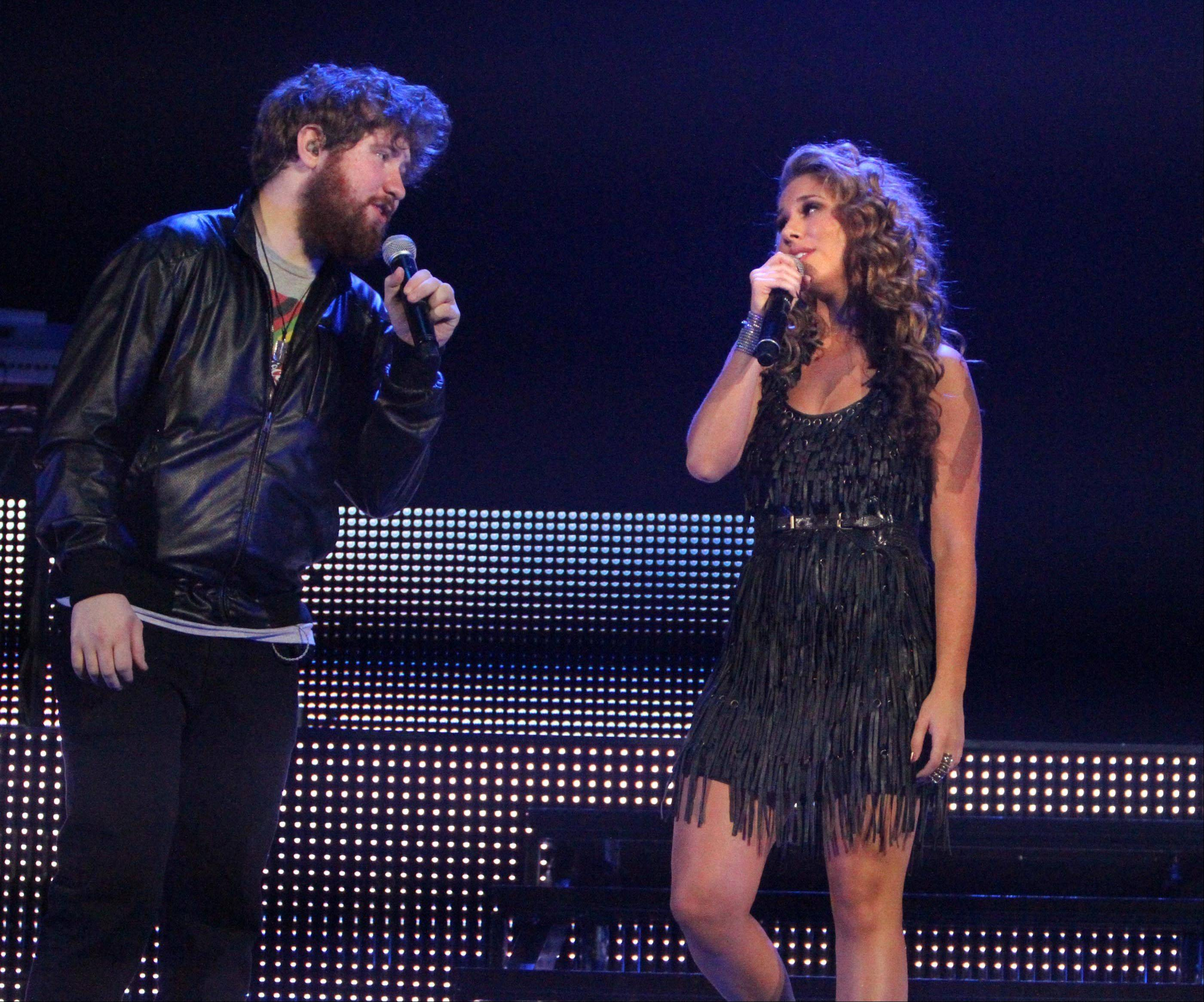 Casey Abrams and Haley Reinhart perform during the American Idol concert.