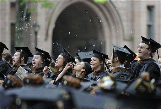 Yale seniors celebrate during commencement exercises in June. Starting next July, graduate and professional students will no longer be eligible for subsidized federal loans.