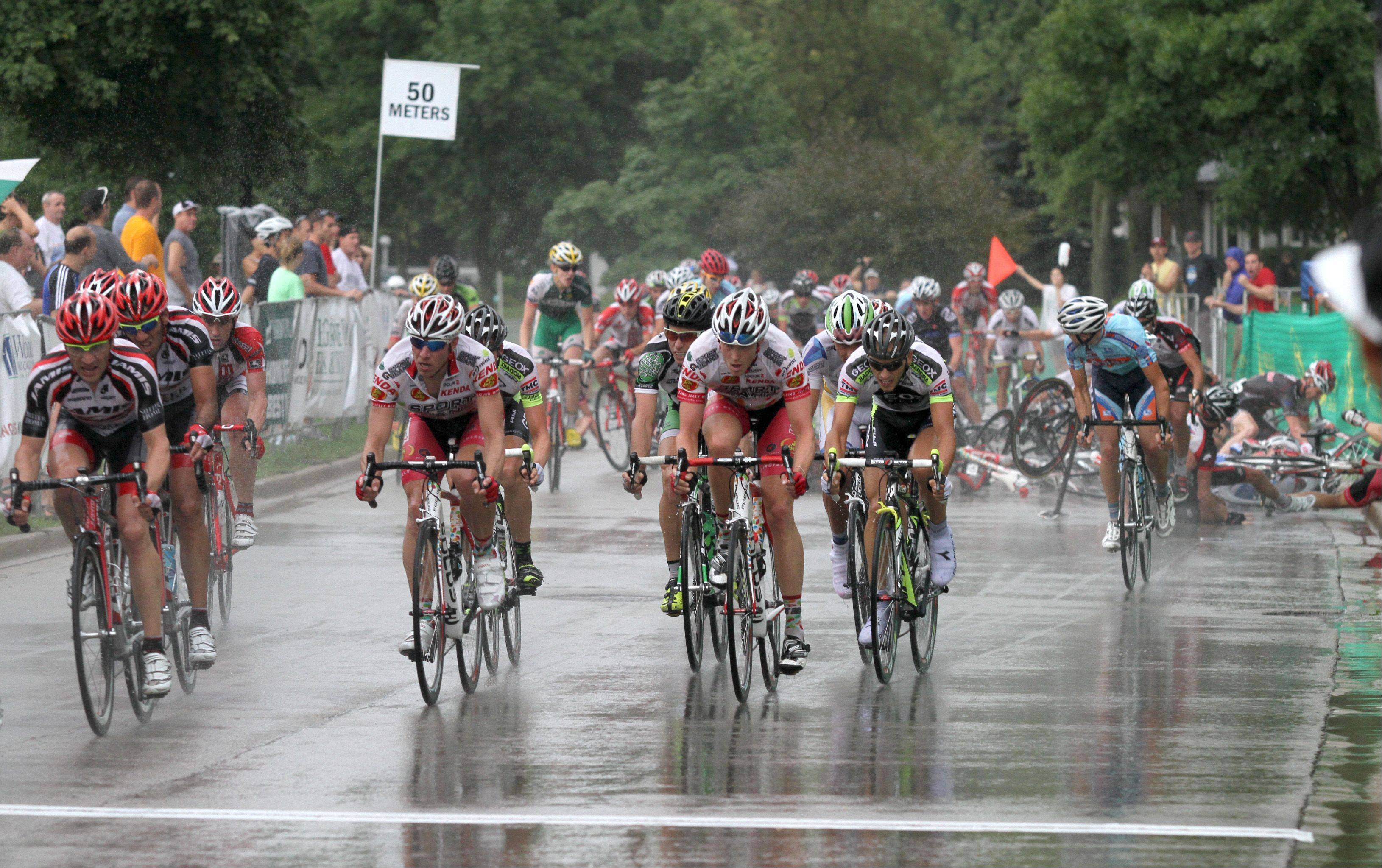 With one lap left in the men's Stage 3 race, riders crashed after a rainstorm Sunday afternoon at the sixth annual Alexian Brothers Tour of Elk Grove.