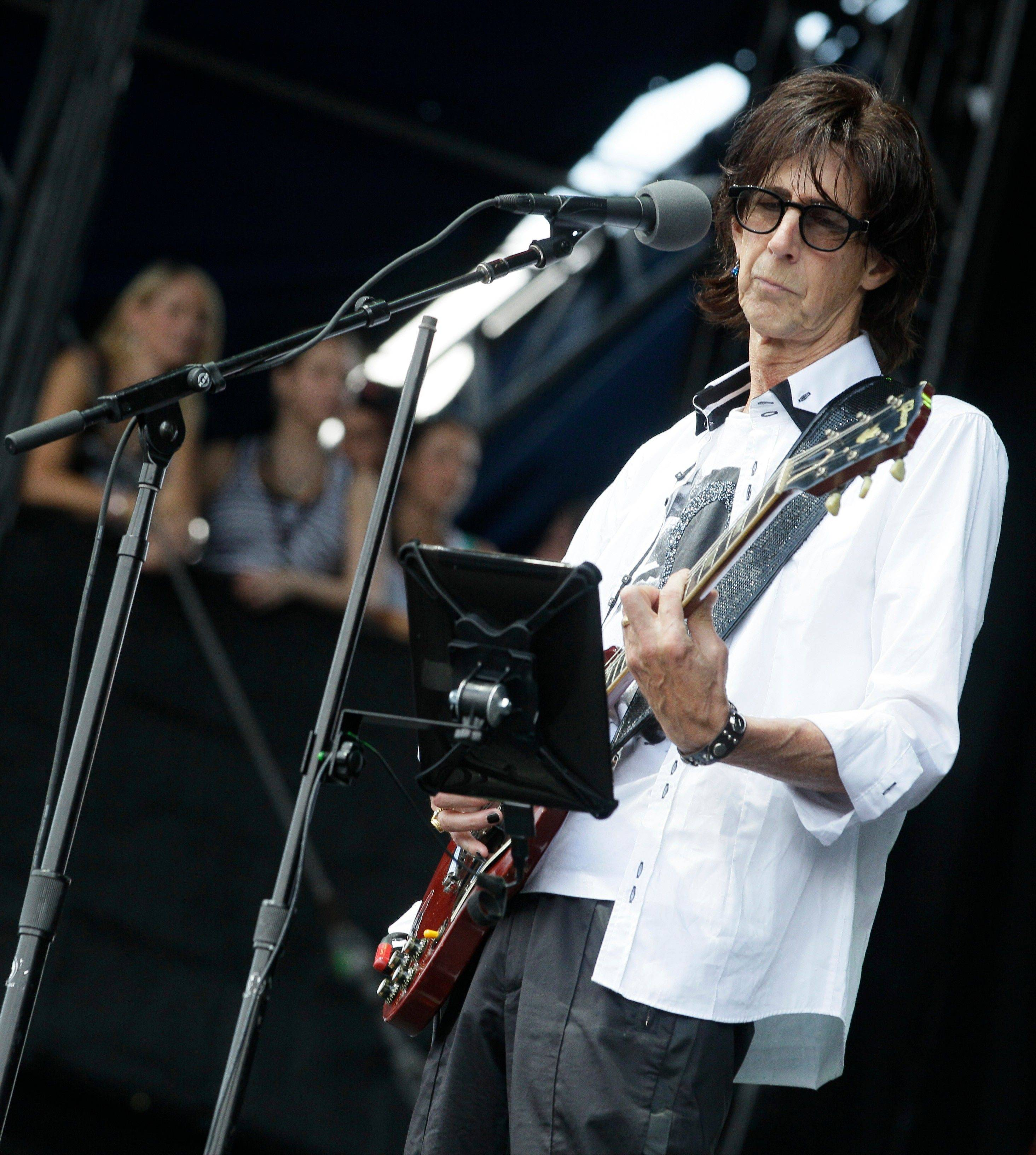 The Cars lead singer Ric Ocasek performs during the Lollapalooza music festival at Grant Park in Chicago, Sunday, Aug. 7, 2011.
