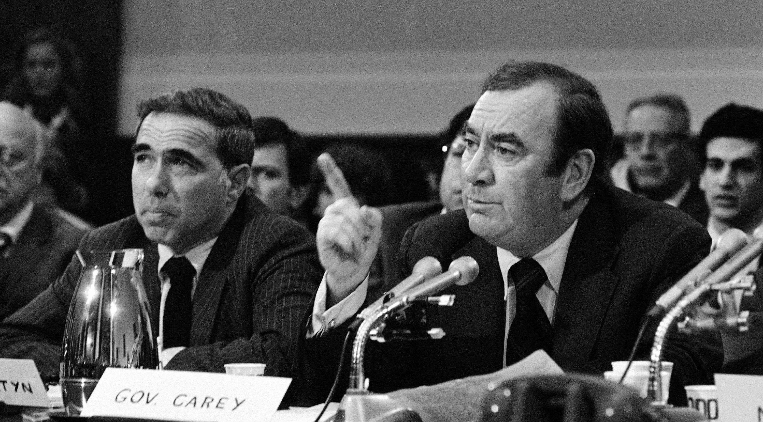 New York Gov. Hugh L. Carey, right, presses members of a U.S. House subcommittee to enact legislation to aid deficit-ridden New York City. Carey died Sunday at age 92.