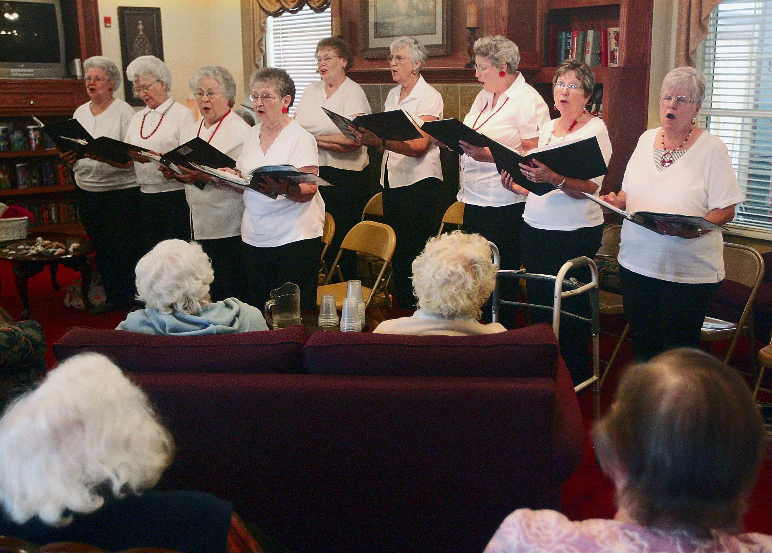 "The singing group Volunteer Voices performs for residents at Bickford Cottage in July in Quincy. The group visits nursing and retirement homes on Friday afternoons to sing ""the old songs"" known to most of the residents. But after nearly 30 years, the group may disband at the end of 2011 if some new members can't be found."
