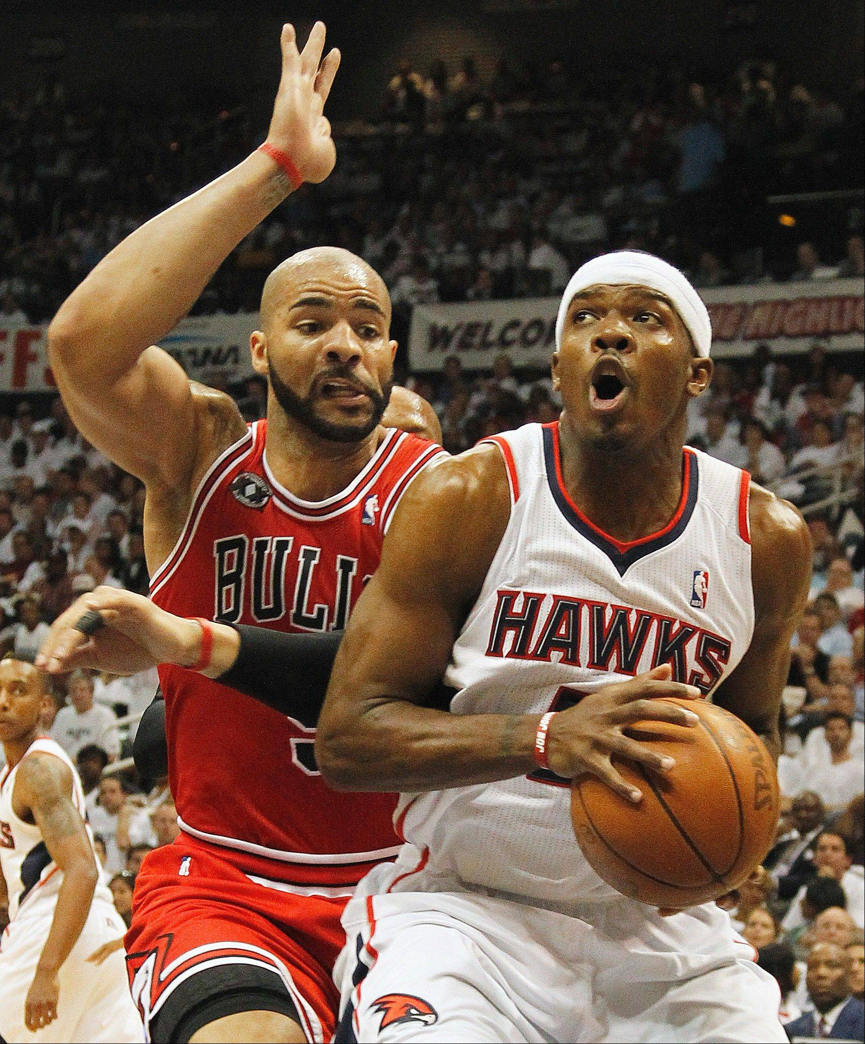 Chicago's Keith Bogans defends Atlanta's Joe Johnson in a playoff game in Atlanta in May. According to a person familiar with the deal, the Hawks and Philips Arena will be sold to California developer and pizza chain owner Alex Meruelo, but the team will remain in Atlanta