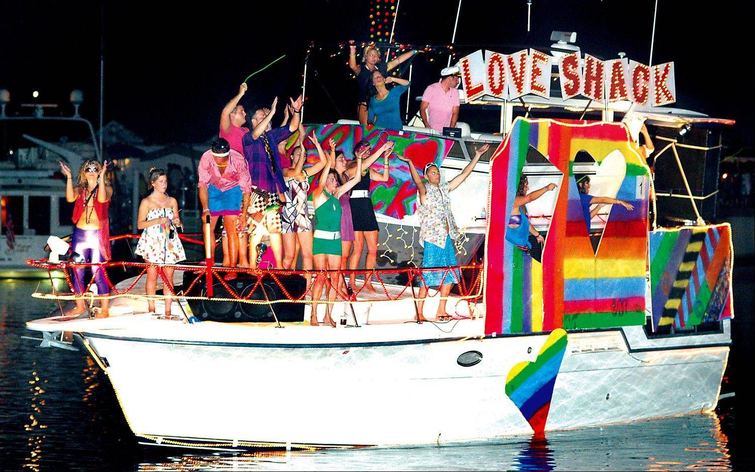 The yacht Splash Dance is transformed into a Love Shack for the Ship & Shore Festival Lighted Boat Parade in New Buffalo, Mich.