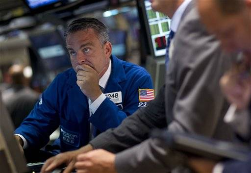 Traders work on the floor of the New York Stock Exchange.(AP Photo/Jin Lee)