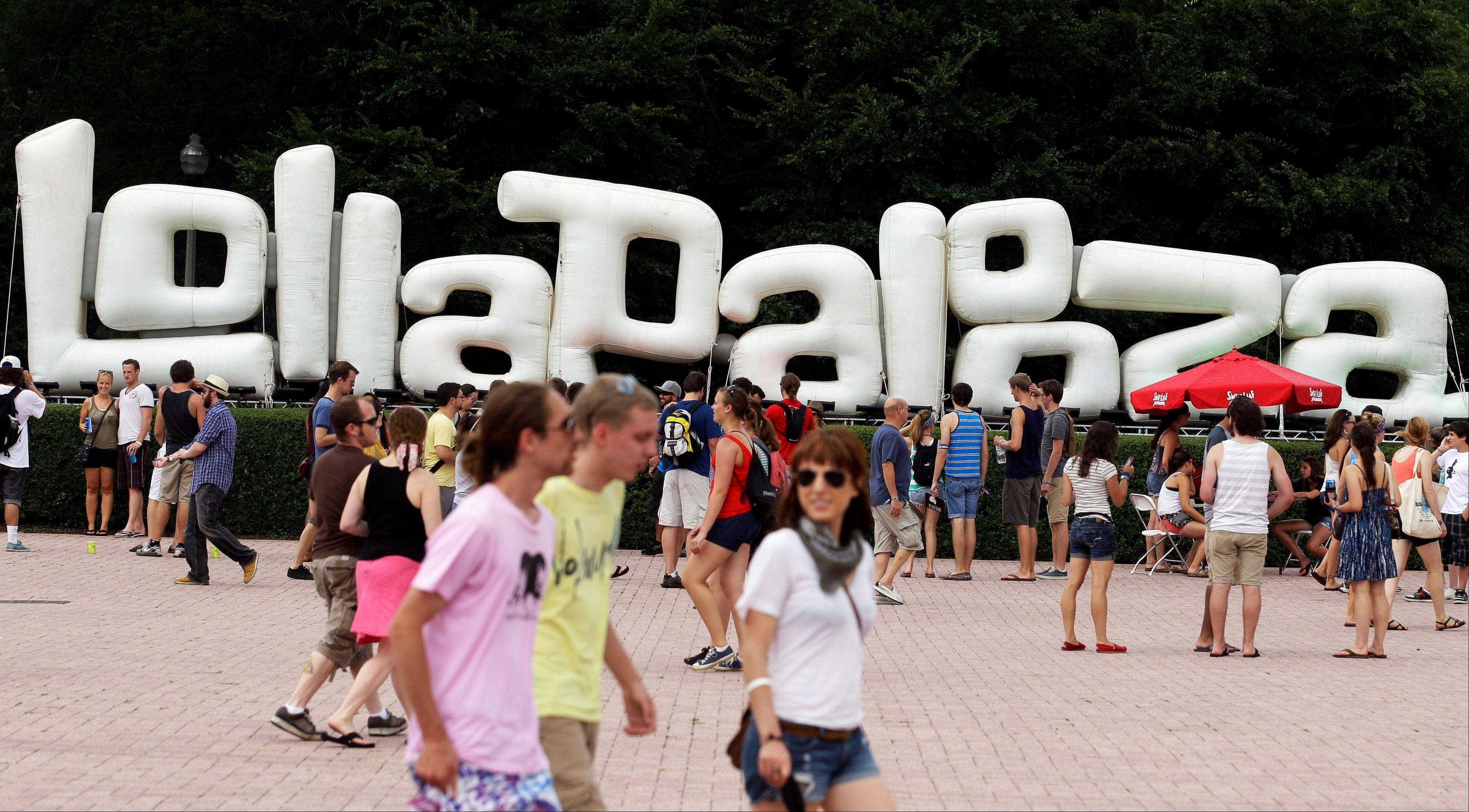 Music fans attend the Lollapalooza music festival Saturday at Grant Park in Chicago. Portugal. The Man's van and trailer full of equipment was stolen Sunday after the close of the festival.