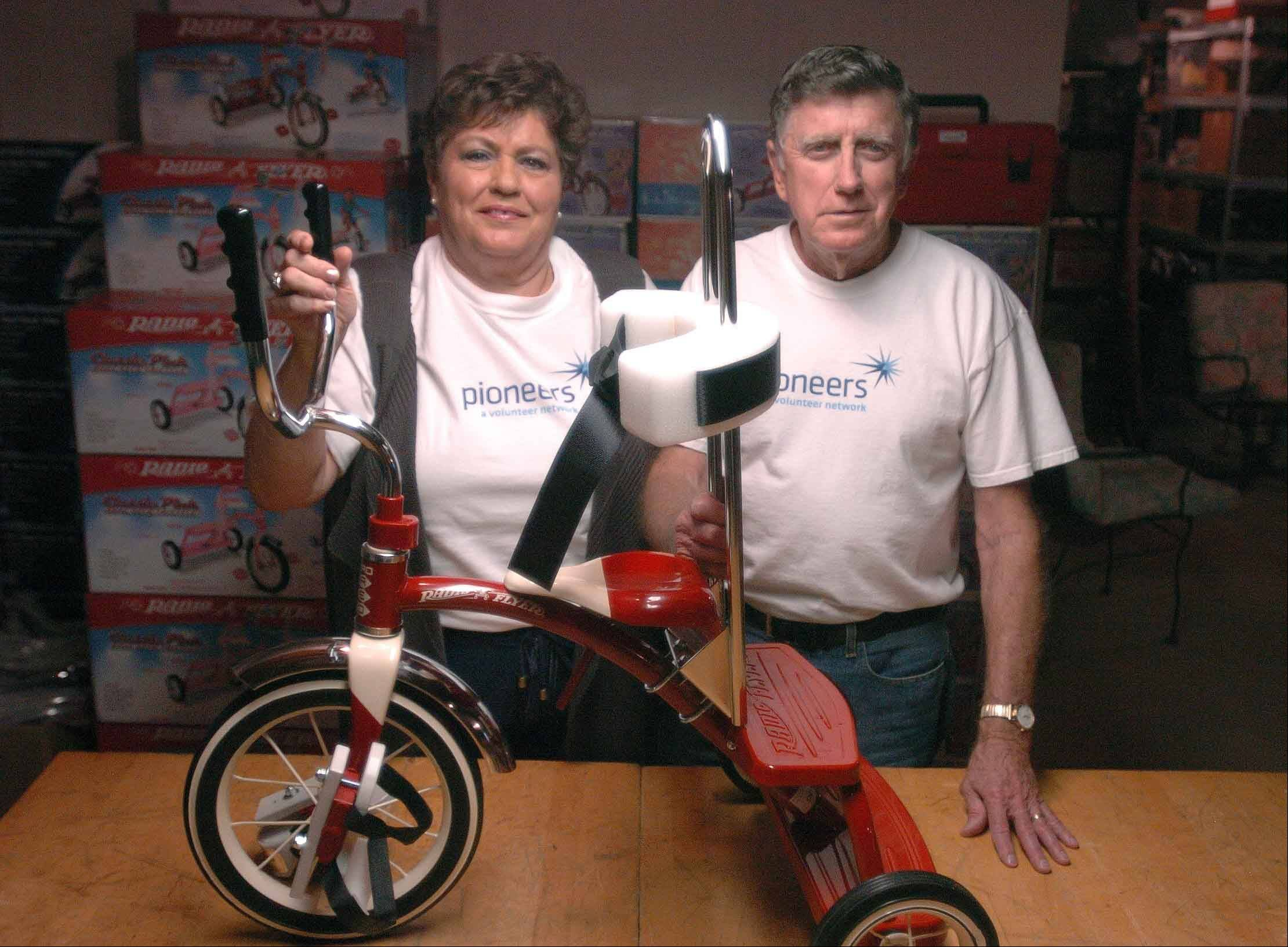Gordon and Connie Hankins of Naperville build tricycles for disabled children in their Naperville home.
