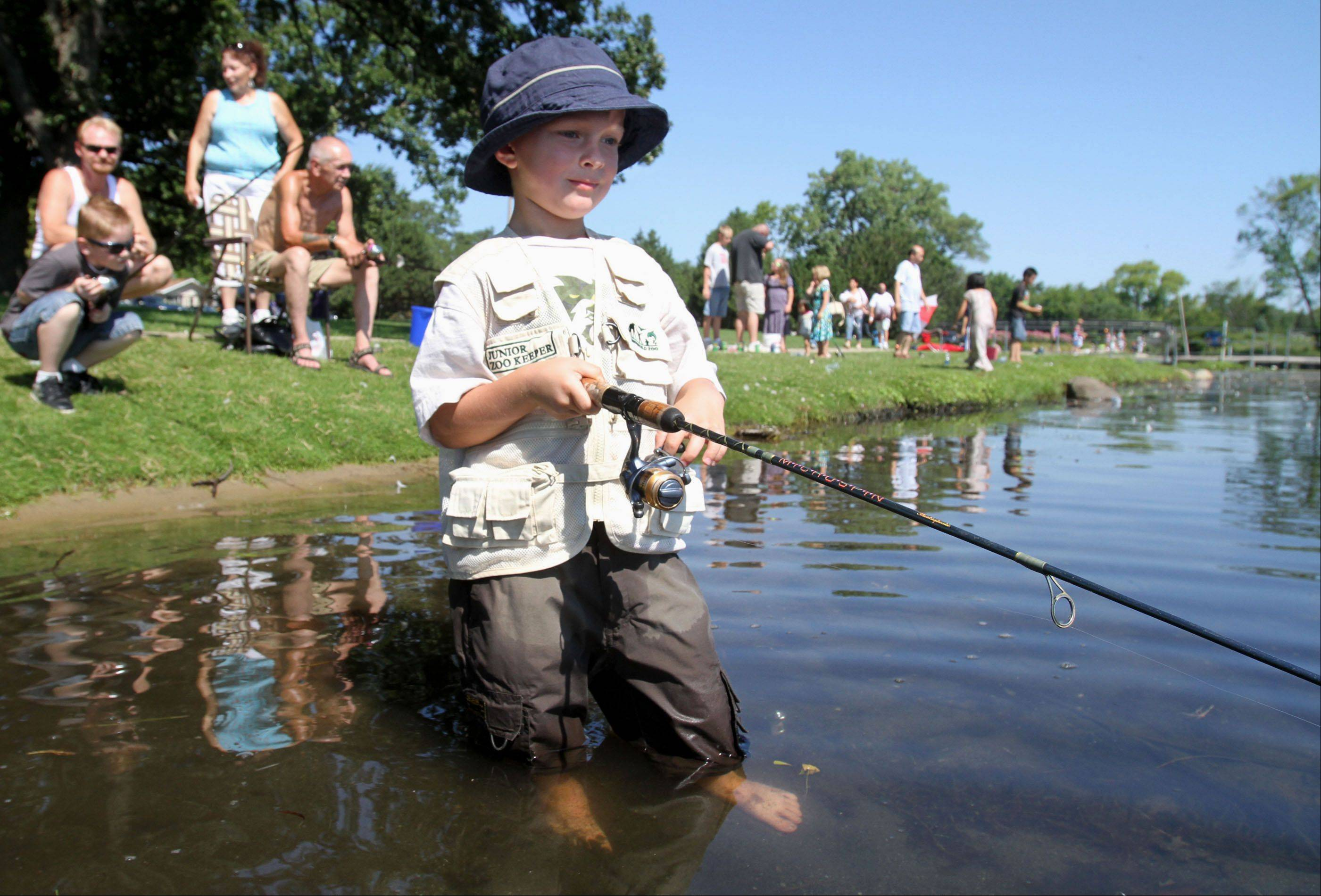 Nick Bryzhenyuk, 5, of McHenry, wades in the water, with no luck, at the �Fishing should be fun� fishing derby held by the Competition Bassmasters of Northern Illinois at Round Lake Beach Park on Saturday.
