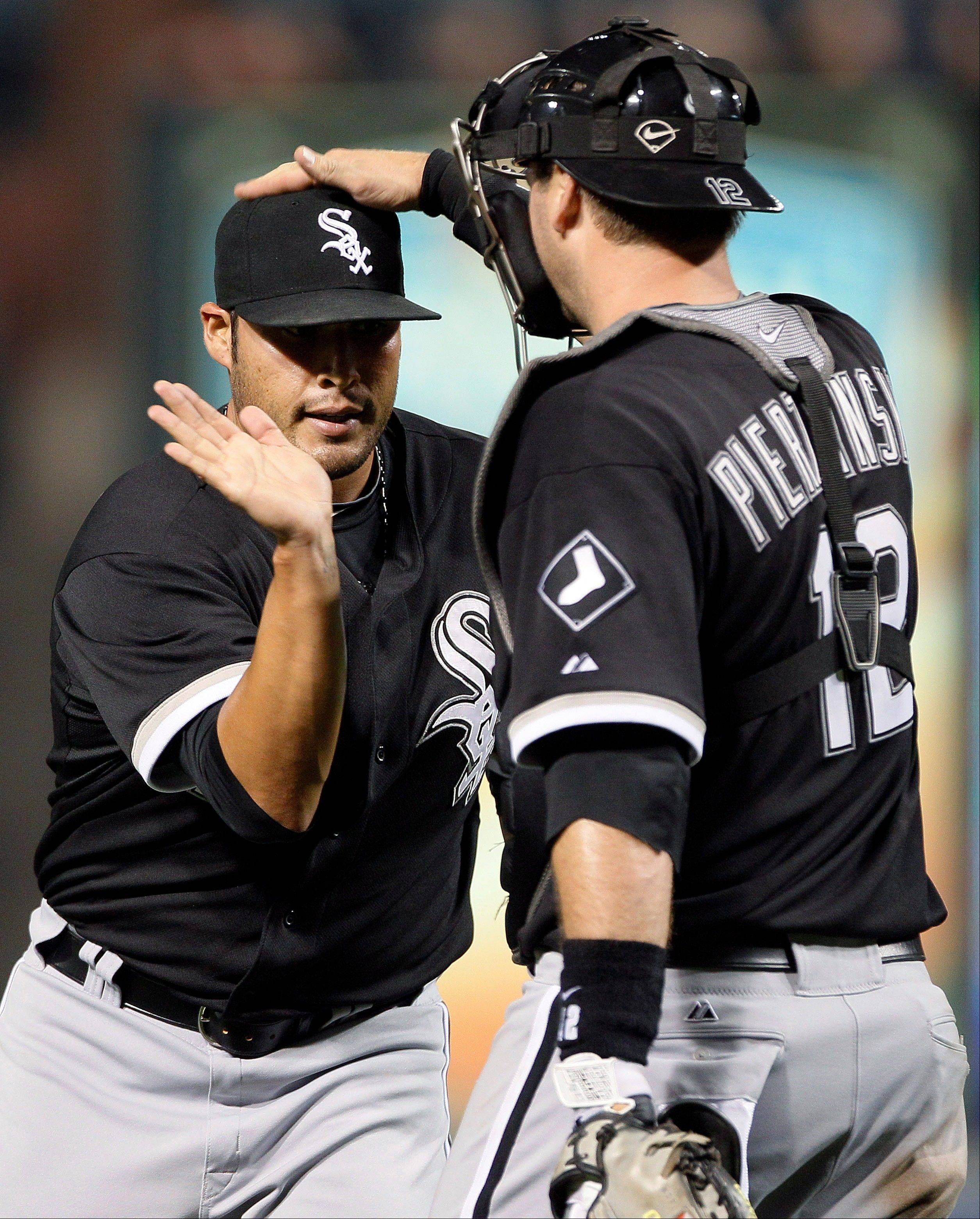 Closer Sergio Santos and catcher A.J. Pierzynski celebrate the White Sox� fourth straight win Monday night.