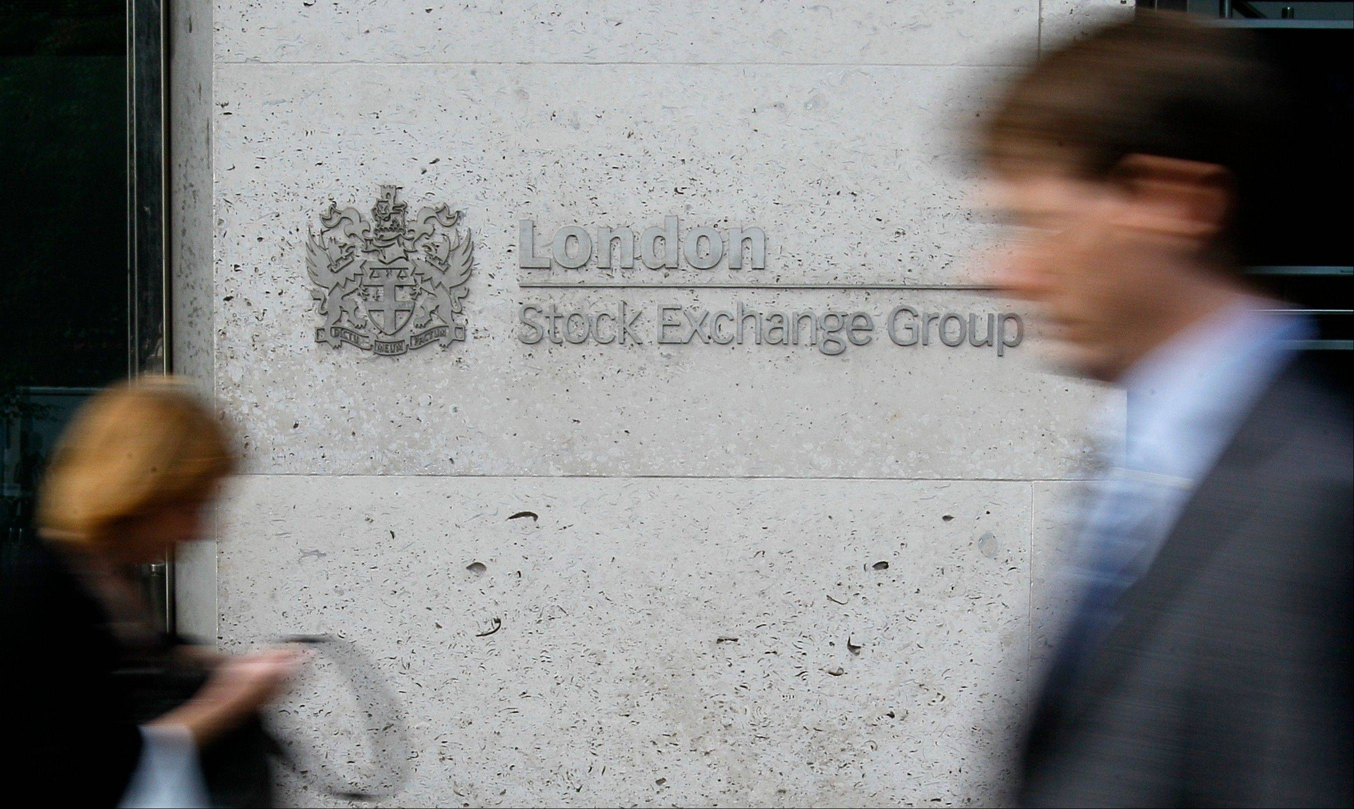 Pedestrians pass the London Stock Exchange in London, Monday, Aug. 8, 2011. Spanish and Italian stocks led European markets higher Monday as investors breathed a sigh of relief that the European Central Bank would buy the two countries' bonds in order to lower their borrowing costs.