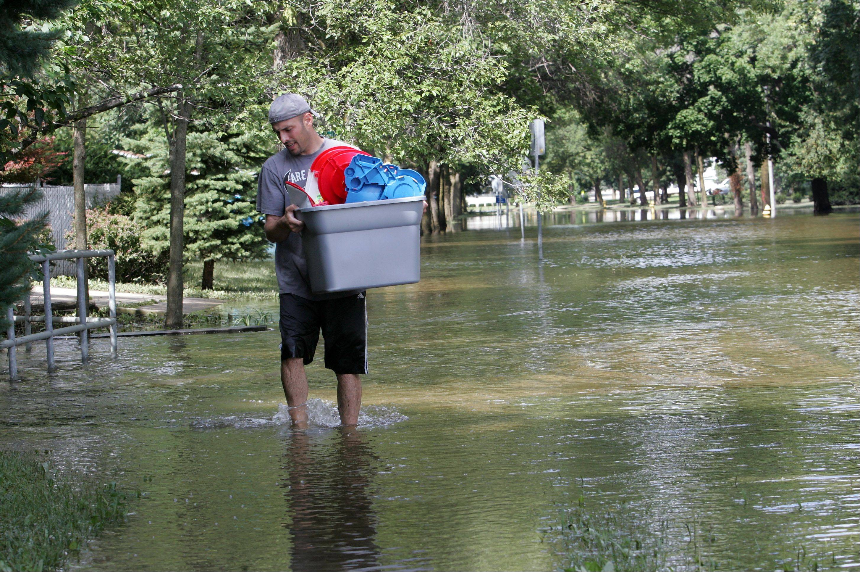 Many residents of Carol Stream's oldest part of town, including John Vent, had to move belongings from their flooded homes last summer. A year later, village officials say they've made improvements in how disaster response is handled.