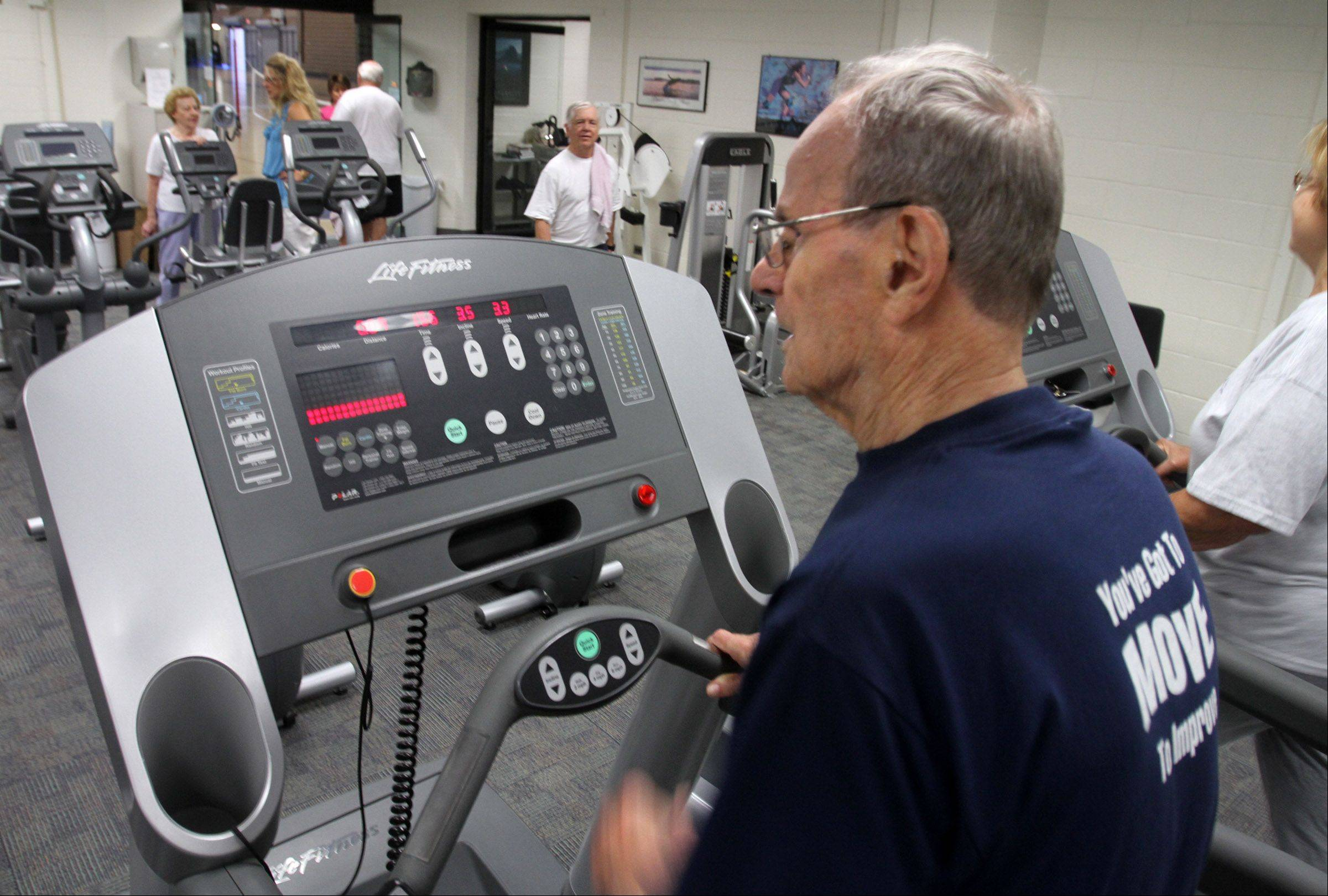 Sam Greco, 90, of Palatine, exercises on the treadmill as part of his daily routine.