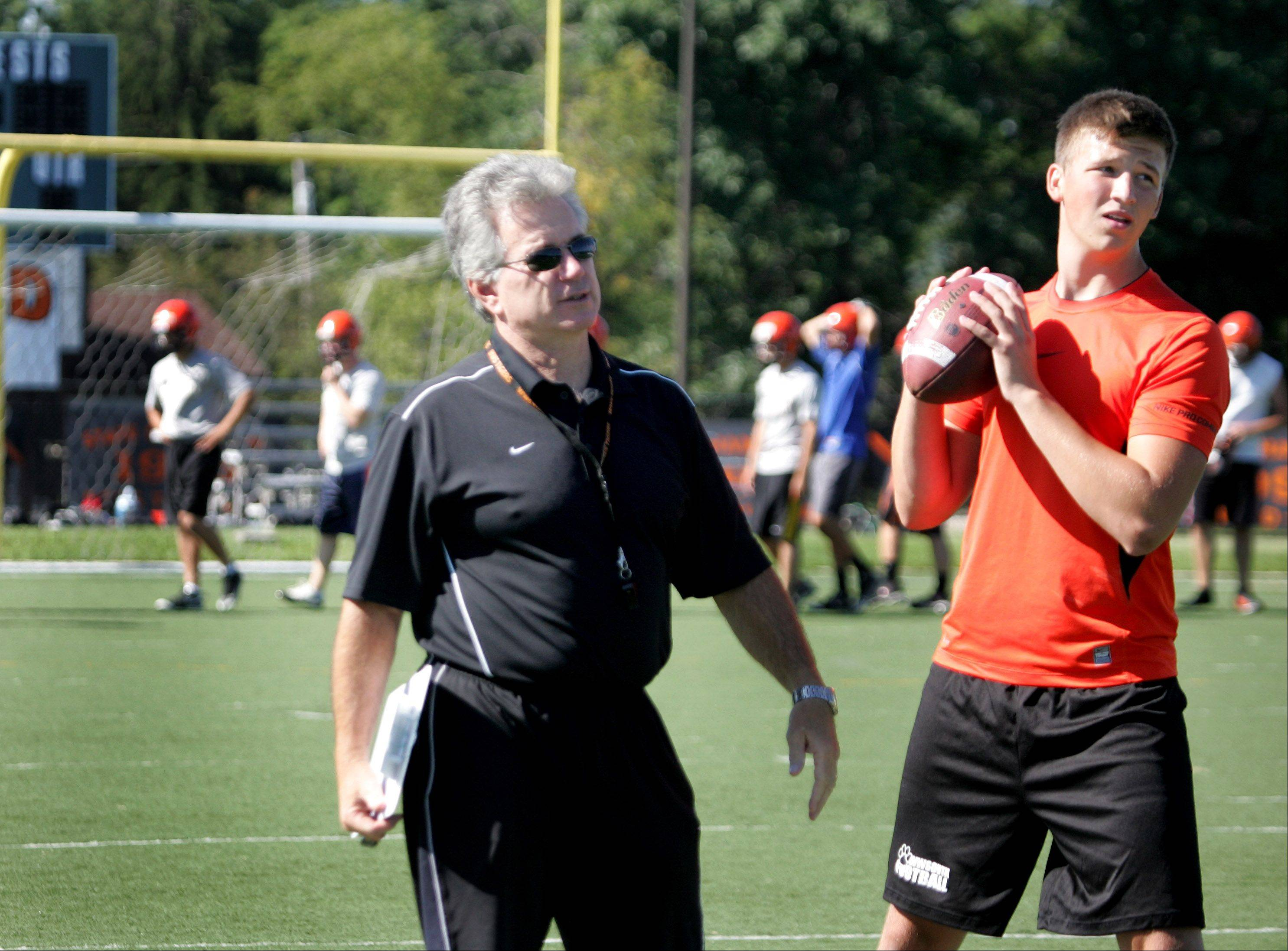 Wheaton Warrenville South quarterback Thaddeus Armstrong works out Wednesday on the watchful eye of coach Ron Muhitch.