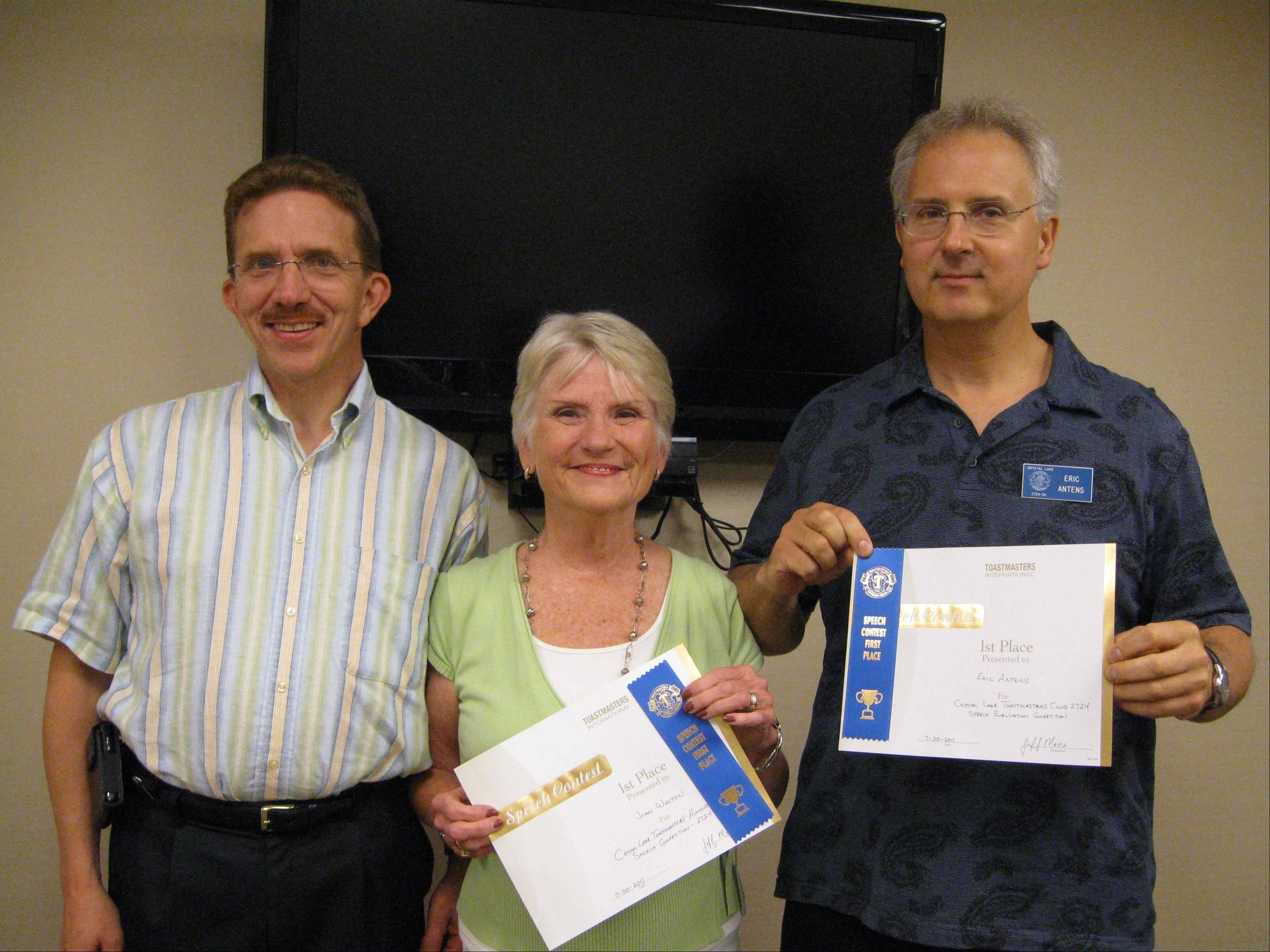 Crystal Lake Toastmasters contest Chairman Duane Lahti, left, congratulates Joan Walton of Huntley and Eric Antens of Cary on their wins in the recent Humorous Speech and Evaluation Speech Contests.
