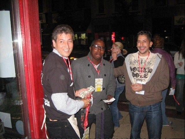 Downtown Neighborhood Association volunteer Victor Gonzalez, left, sells Pub Crawl passports and lanyards at the entrance to the Martini Room, 161 E. Chicago St., during last year's Downtown Elgin Pub Crawl.