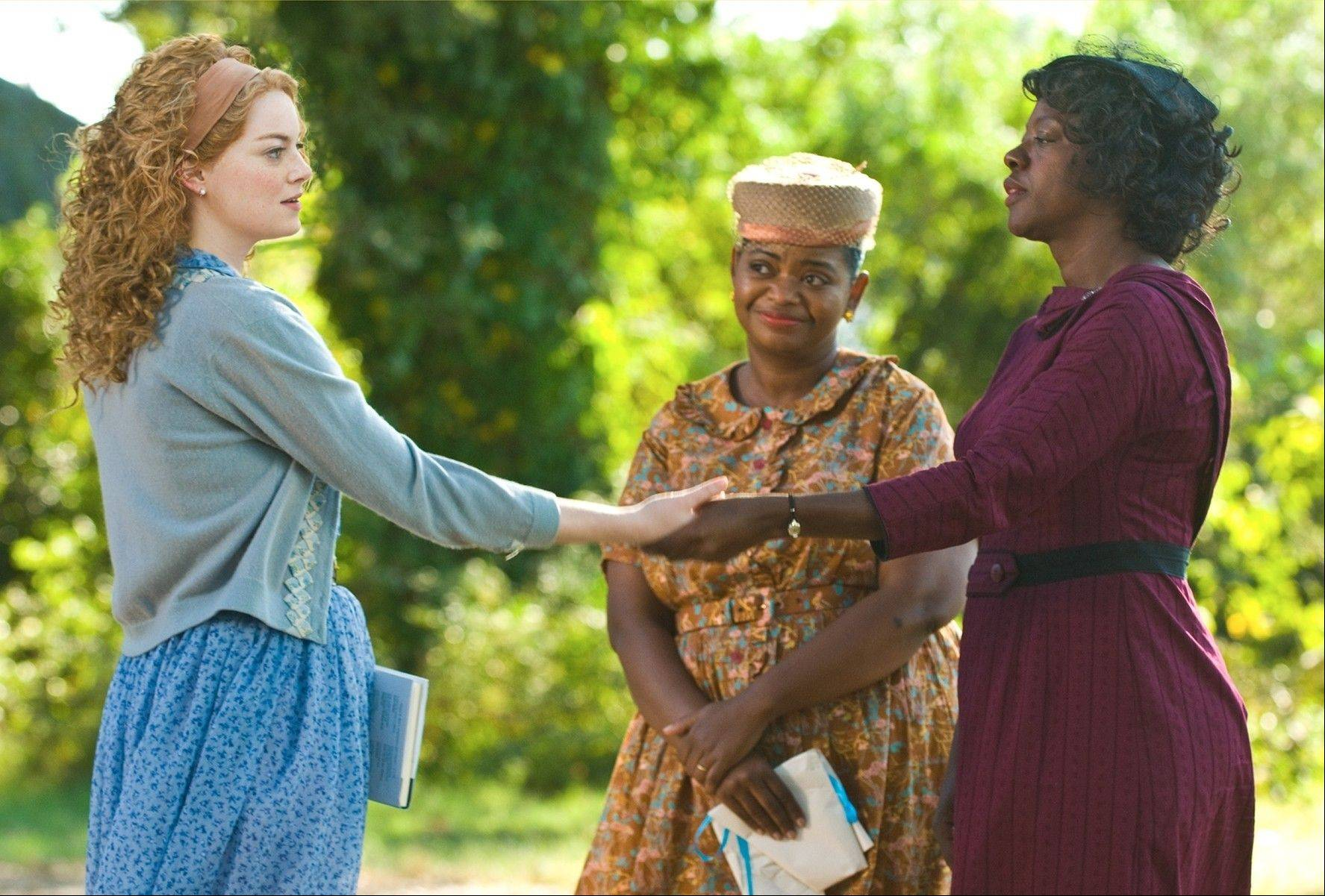 "Skeeter (Emma Stone), left, befriends ""The Help"" — Minny Jackson (Octavia Spencer) and Aibileen Clark (Viola Davis) — so she can write an expose on the snooty, racist white women in a Southern town during the Civil Rights era."