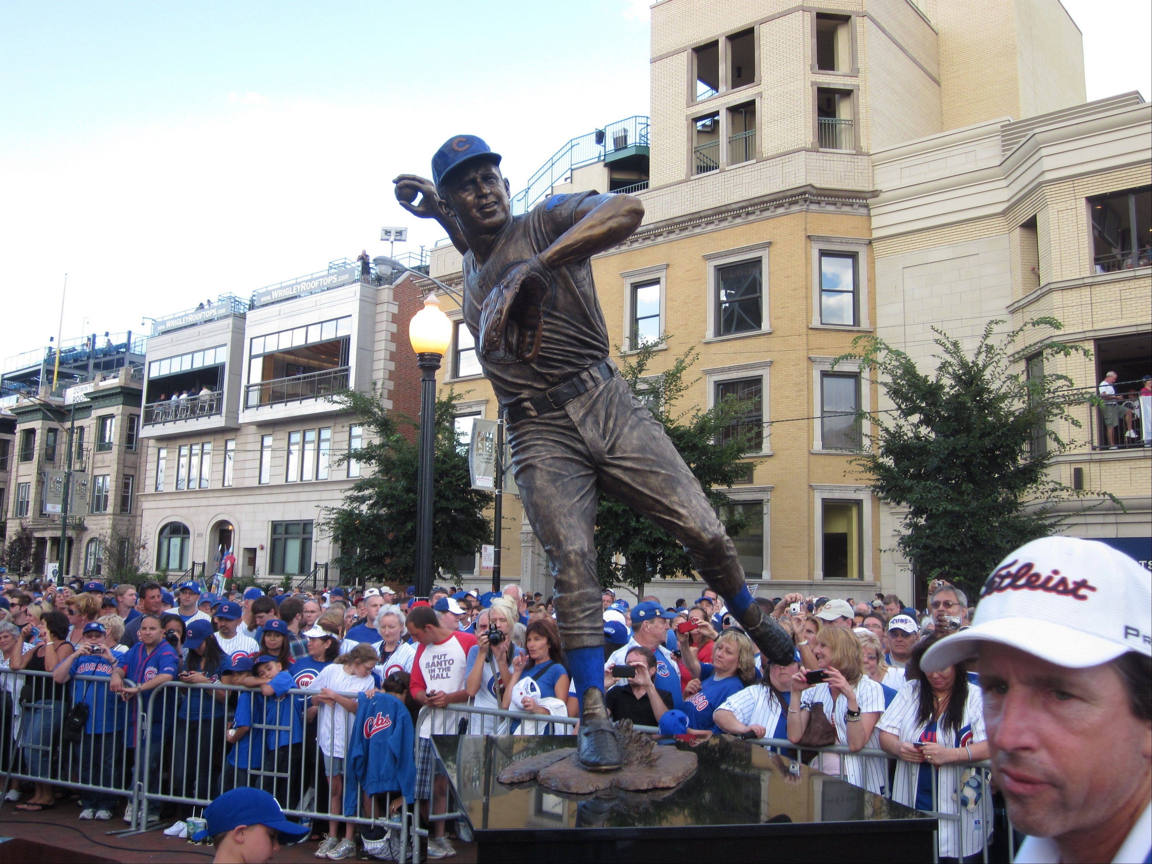 Fans gather outside Wrigley Field for the unveiling ceremony of the Ron Santo statue.