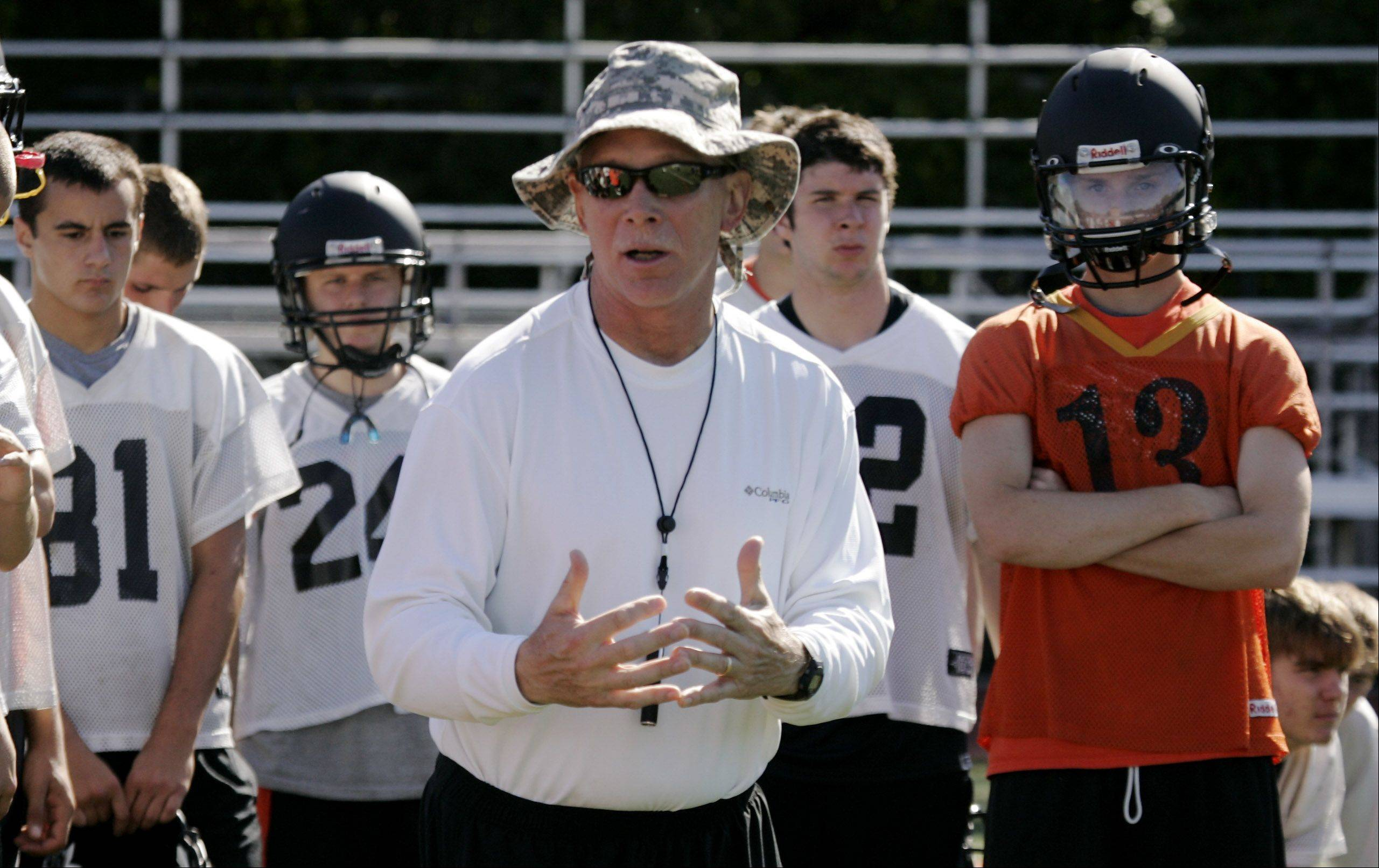 Head coach Randy Kuceyeski talks to the team during the first day of football practice Wednesday at Libertyville High School. Kuceyeski is retiring at the end of this season.
