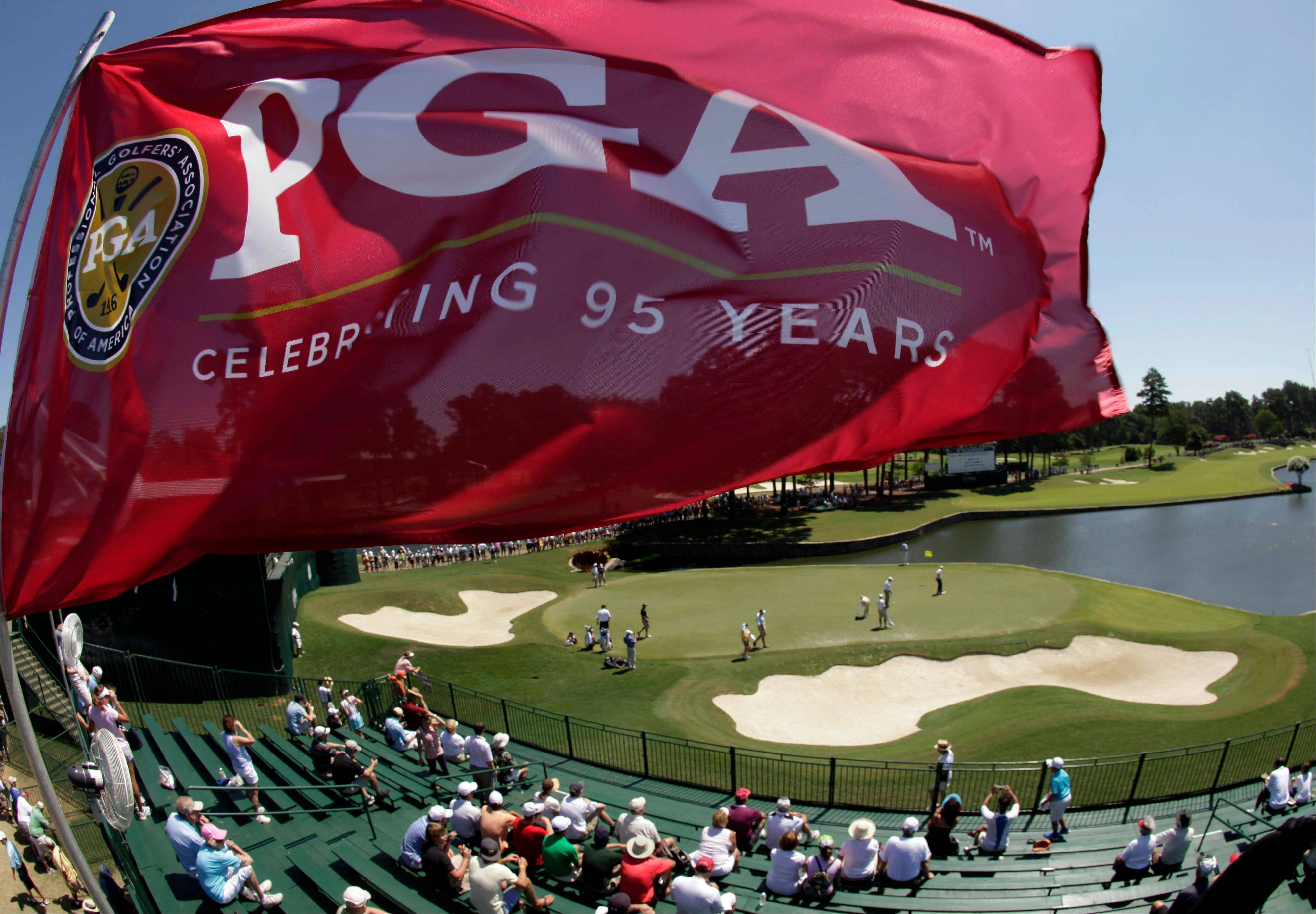 A flag flies over the stands Wednesday on the 18th hole during a practice round for the PGA Championship golf tournament at the Atlanta Athletic Club in Johns Creek, Ga.