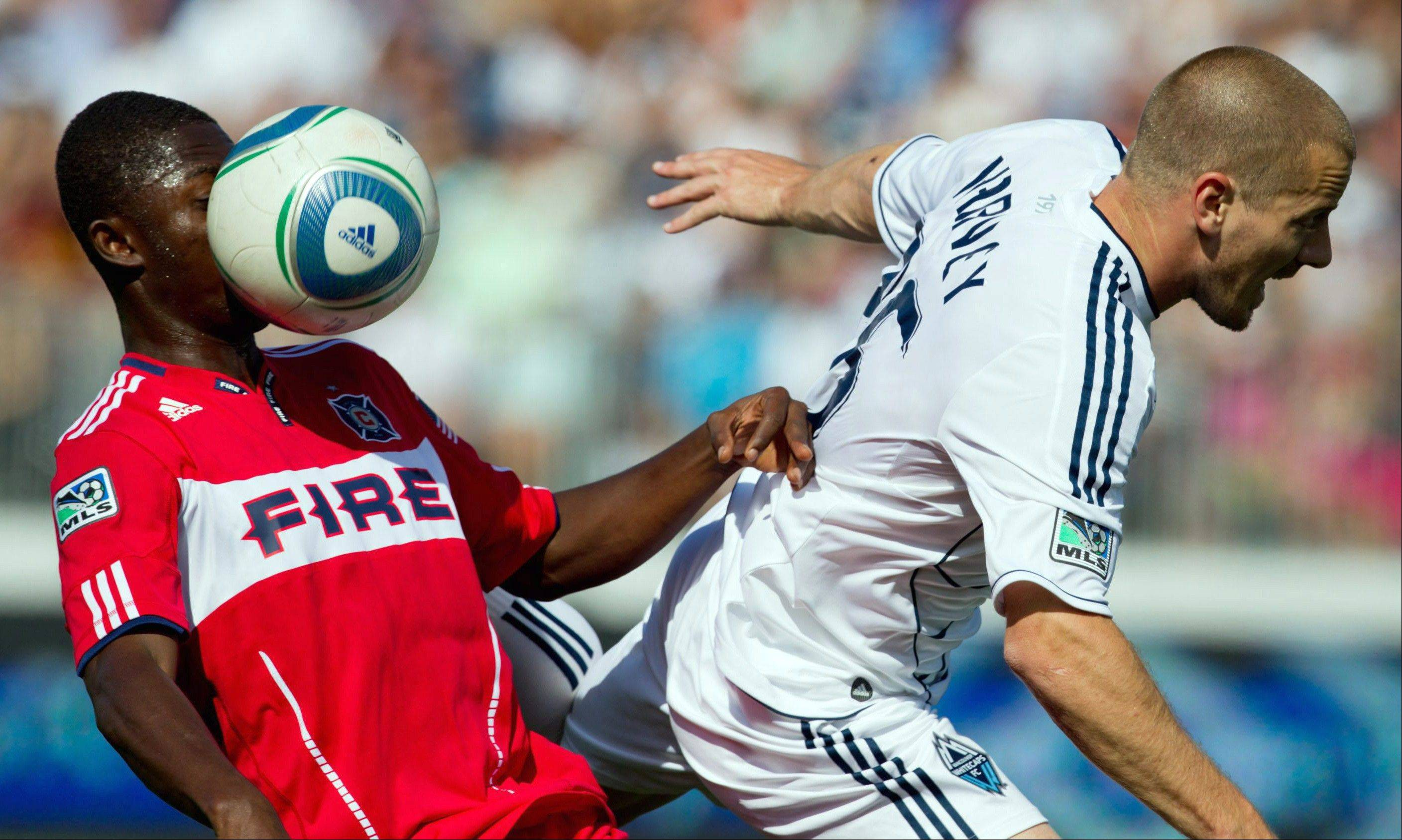 After Sunday's 4-2 loss Sunday at Vancouver, the Chicago Fire has been outscored by expansion teams 9-4 this season, and has managed only two wins in its last 22 games. The Fire's Patrick Nyarko, left, took a ball to the face as he battled Vancouver's Jordan Harvey on Sunday.