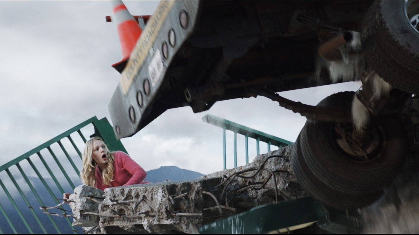 "Molly (Emma Bell) struggles to survive a horrible bridge collapse in the horror sequel ""Final Destination 5."" It's in 3-D, of course."