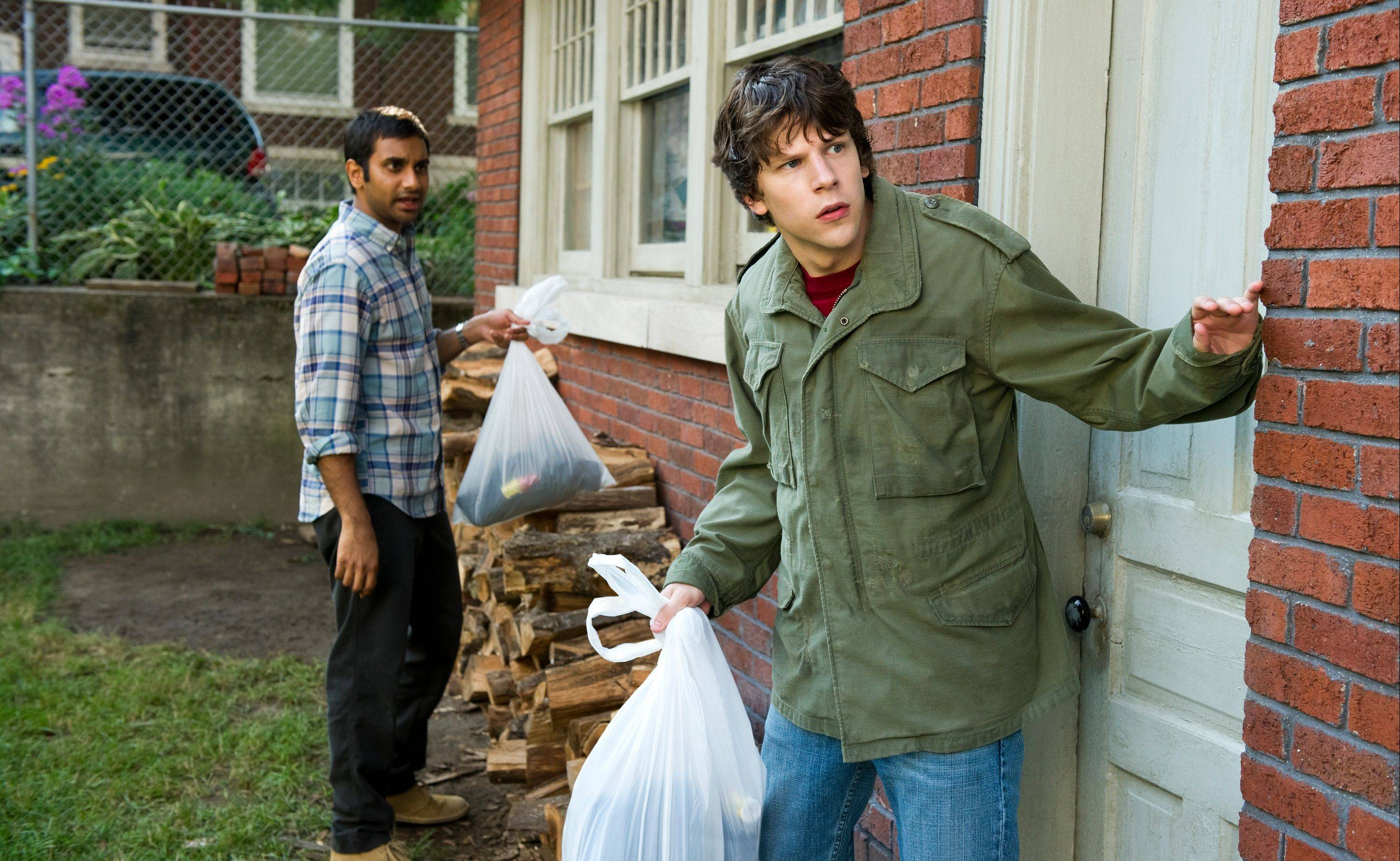 "Chet (Aziz Ansari), left, and Nick (Jesse Eisenberg) plot to steal a car in the shrill action comedy ""30 Minutes or Less."""
