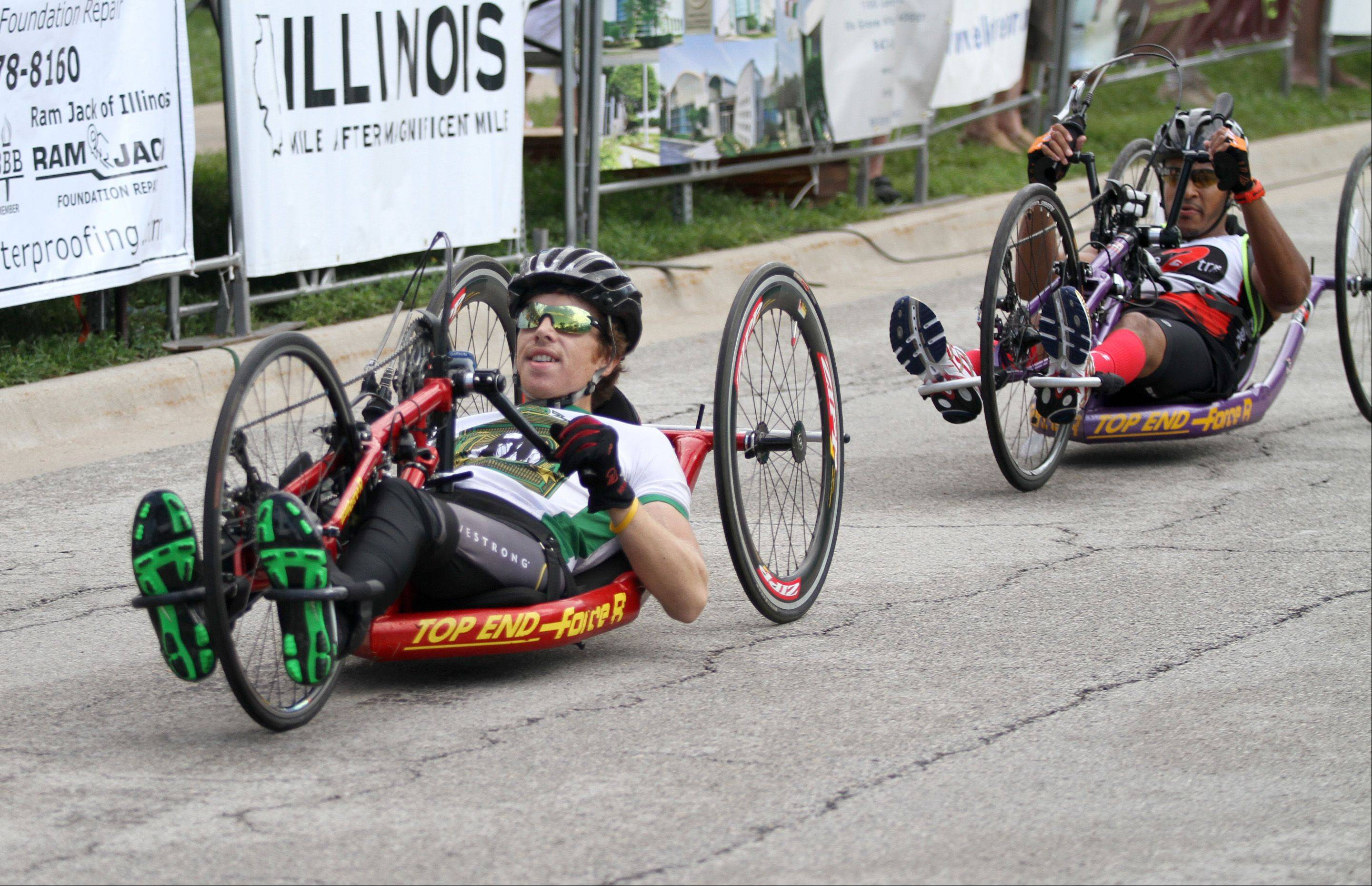 Mike Welch, front, and Iraq War veteran Sgt. Dan Casera, complete a lap on Sunday.