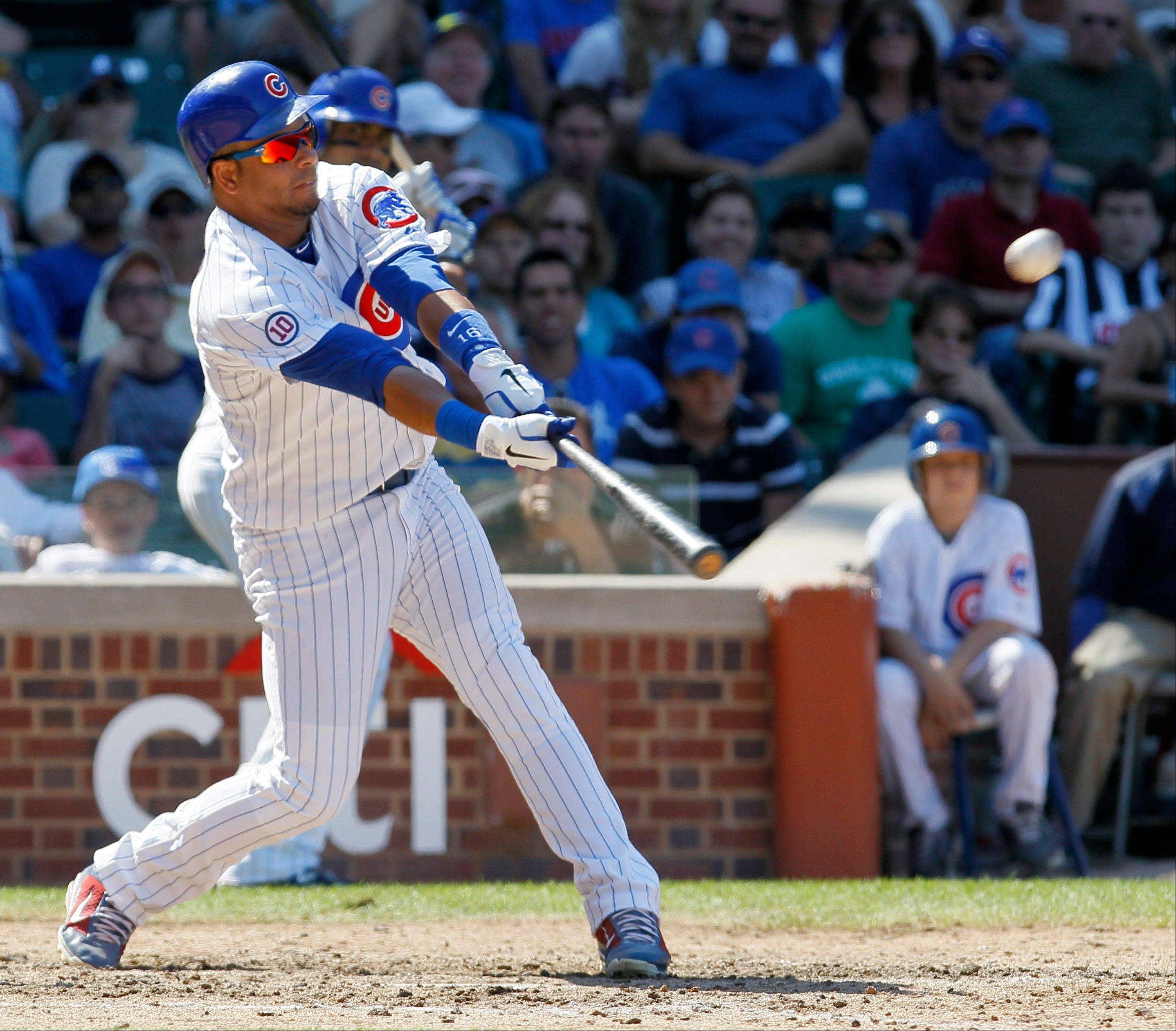 Aramis Ramirez swings follows through on a 2-run homer in the seventh inning Thursday at Wrigley Field.