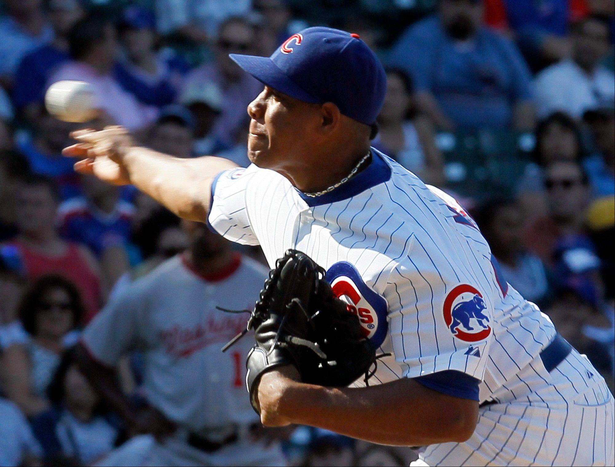 Carlos Marmol worked out of a bases-loaded, nobody-out jam and managed to pick up his 26th save as the Cubs beat the Nationals 4-3.