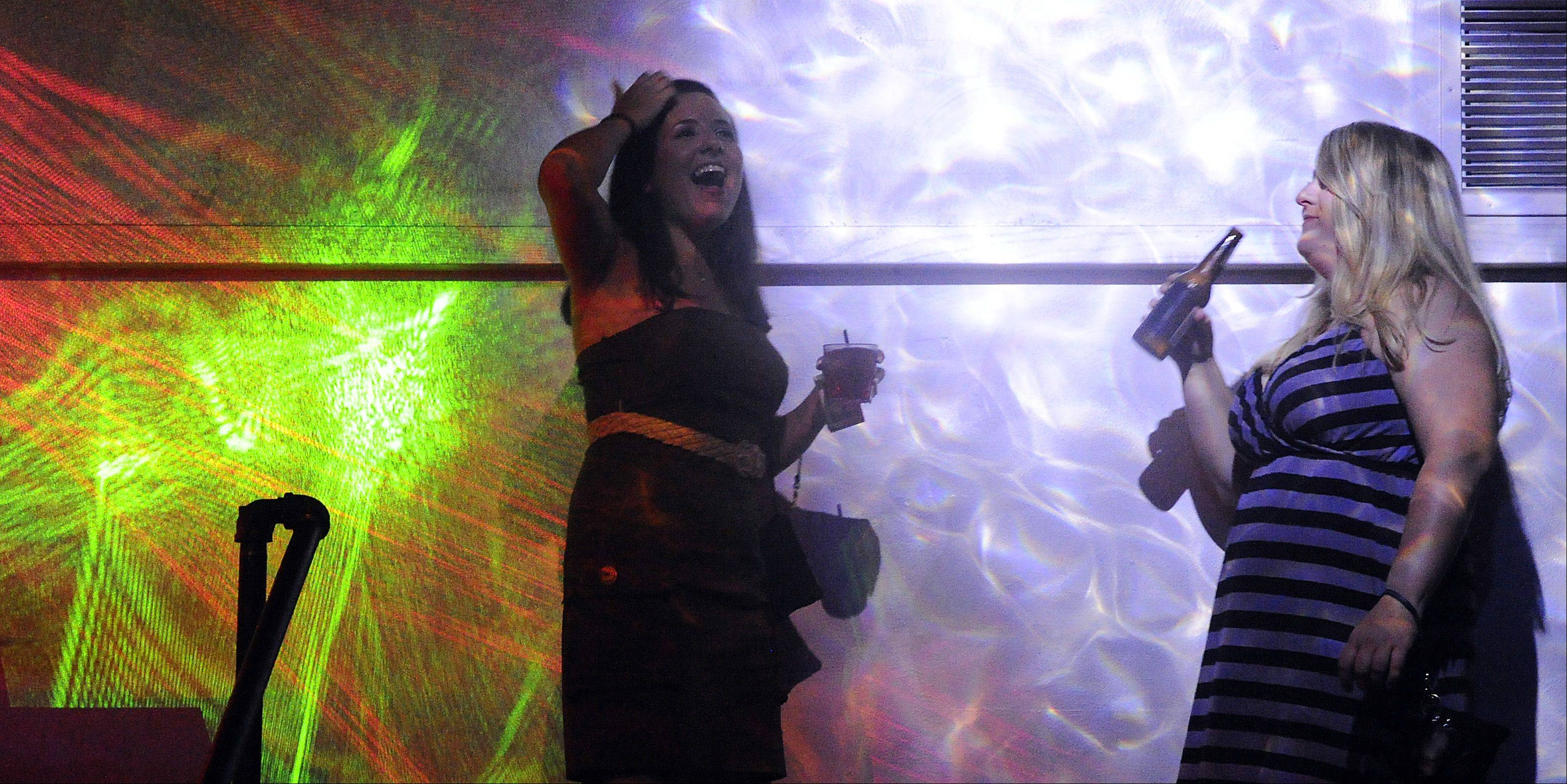 Sara Marks of Palatine and Sara Thompson of Roselle dance the night away at Drink in Schaumburg.