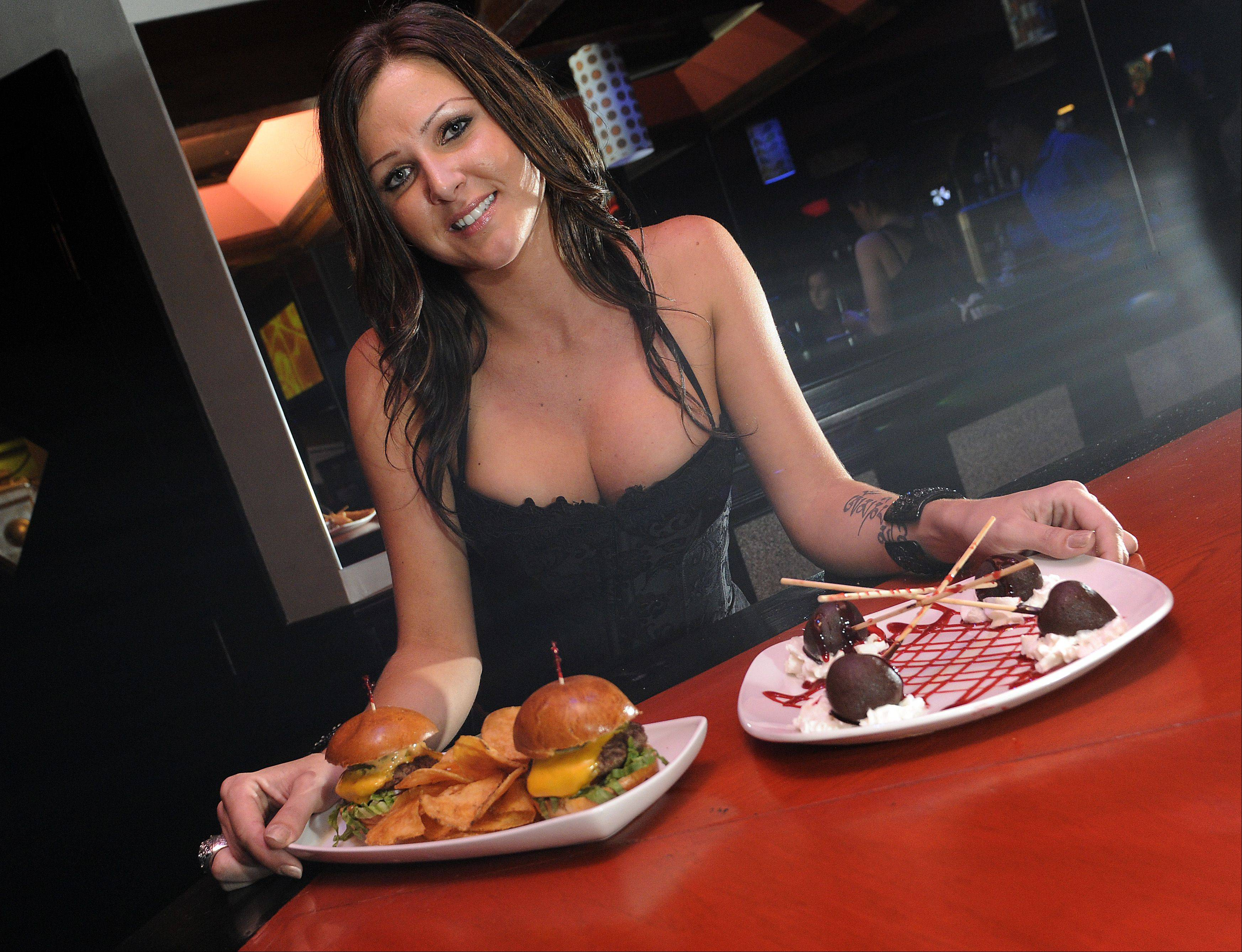 Jacquelyn Johnson of Villa Park serves up sliders and dessert at Drink in Schaumburg.
