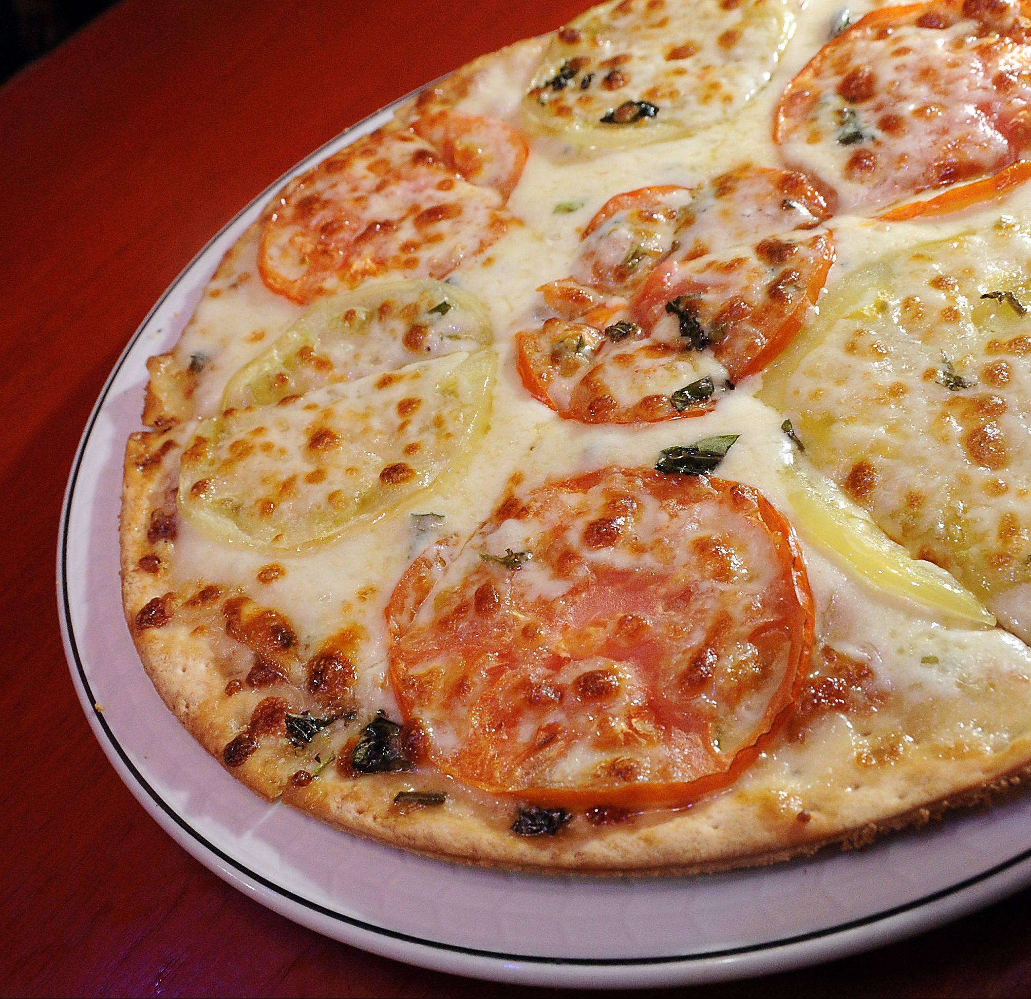 Pizza is just one of the items meant to be shared on Drink's menu.